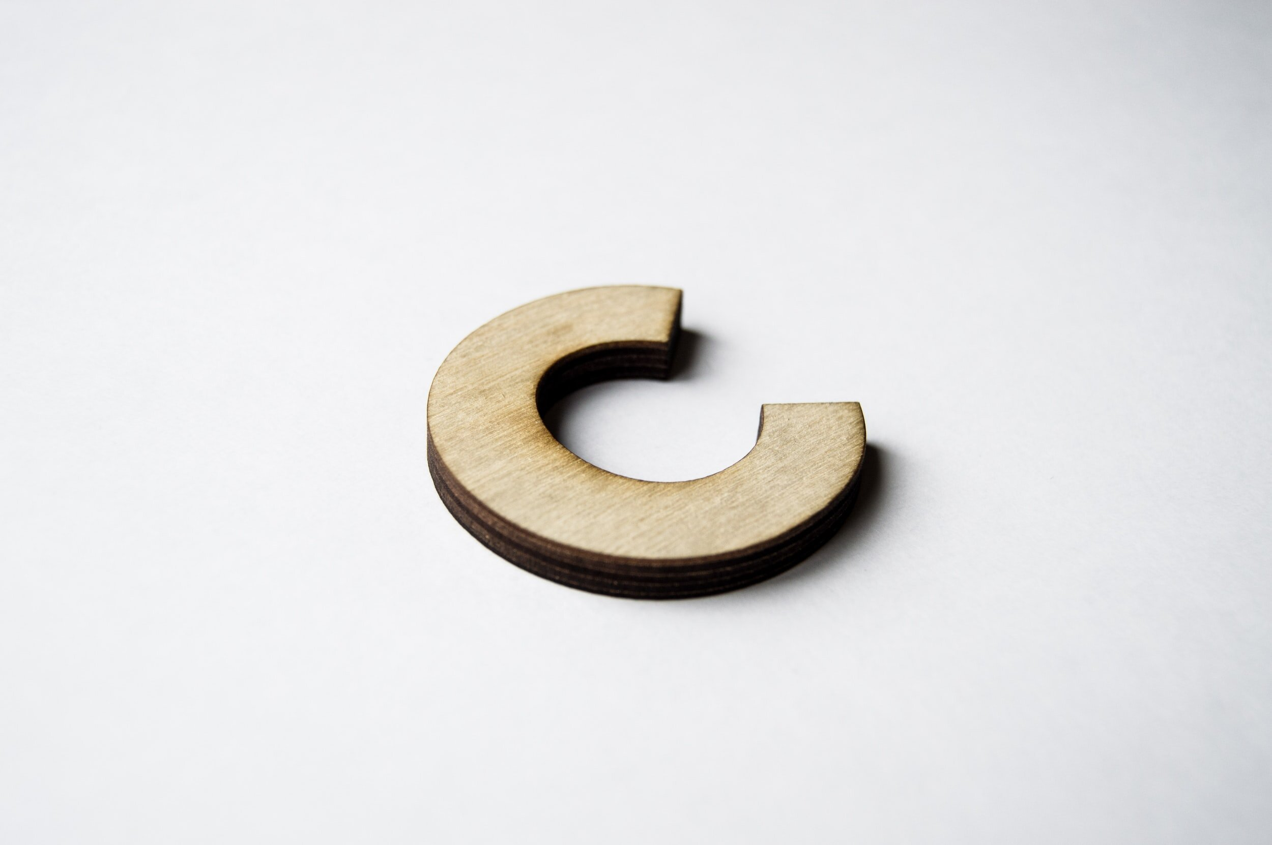 wooden-c-in-on-white-backdrop