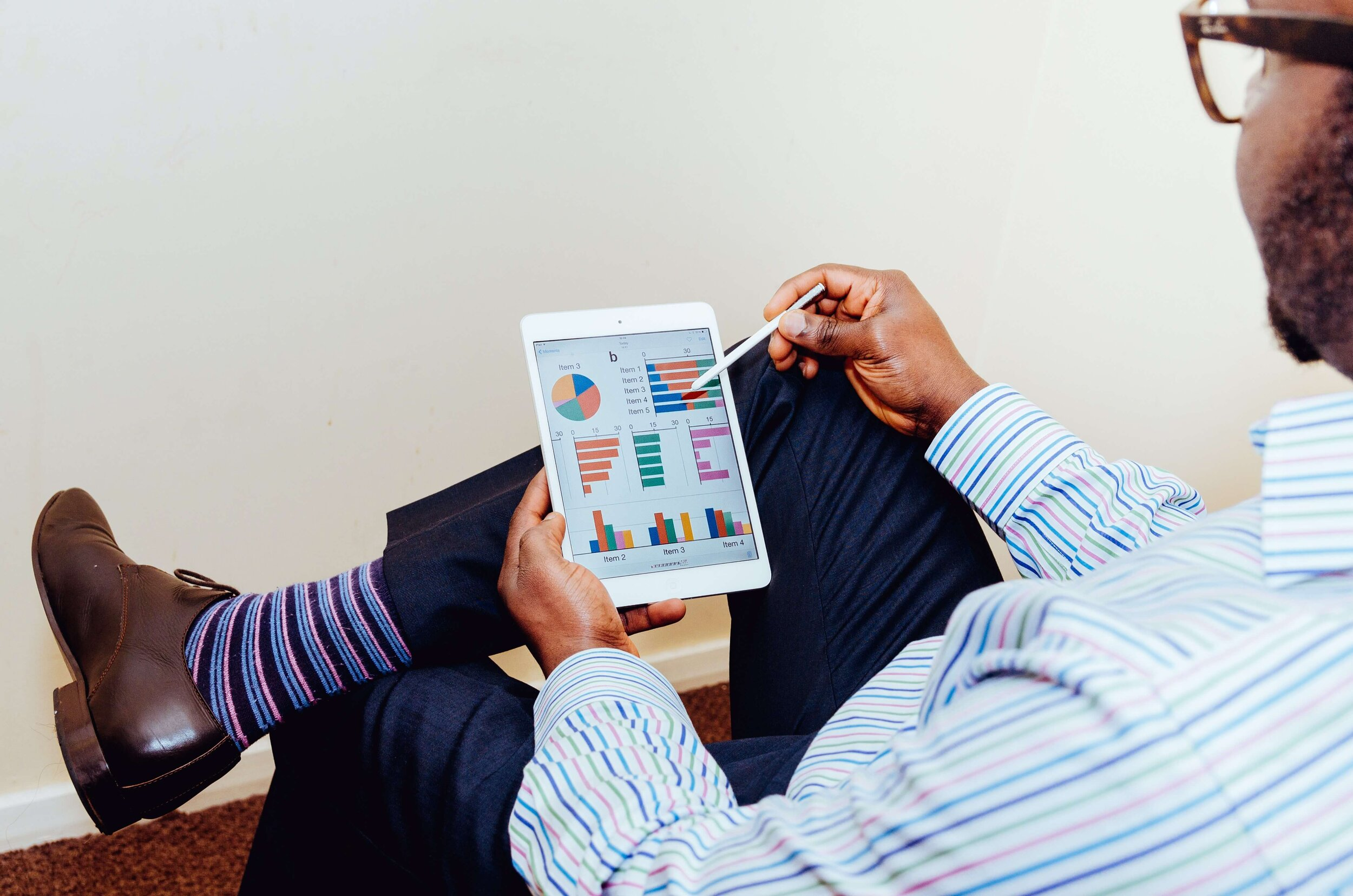 man-reviewing-graphs-and-charts-on-tablet