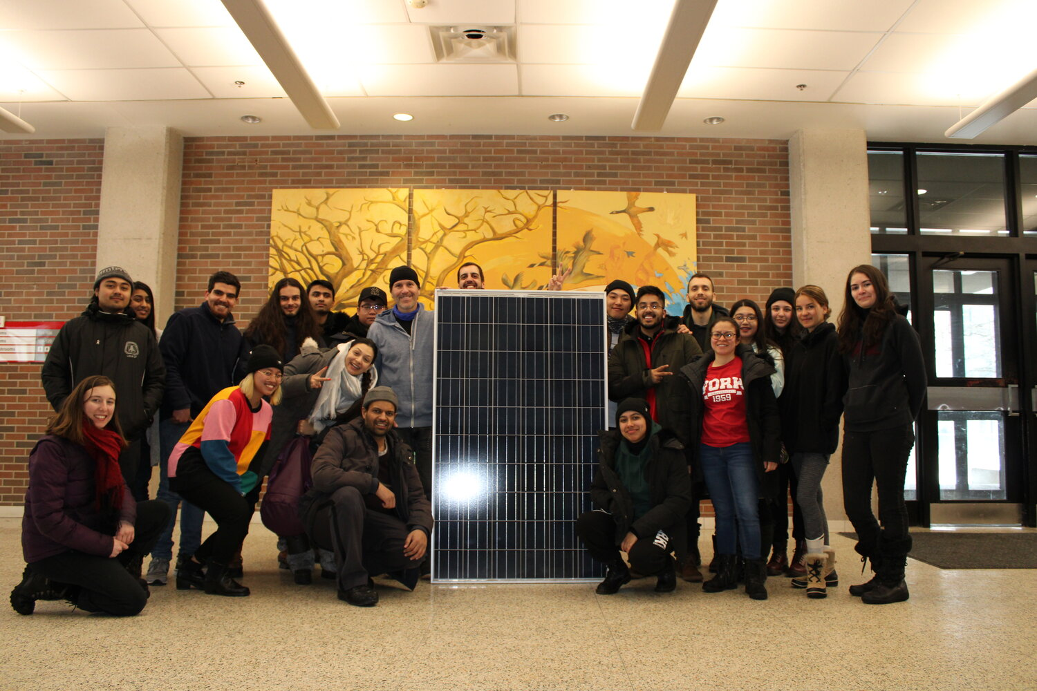 Students and faculty pose during a solar panel installation February 29th, 2020. Photo credit: Codrina Ibanescu