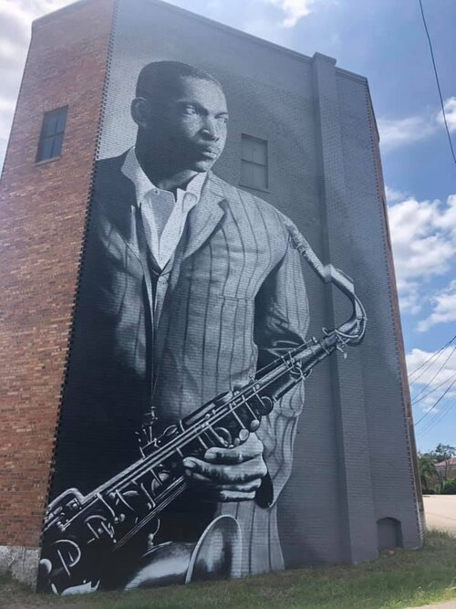 The first installment of the N.C. Musicians Mural Project, completed in mid-June, depicts pioneering jazz musician John Coltrane in his hometown of Hamlet.  Courtesy Scott Nurkin
