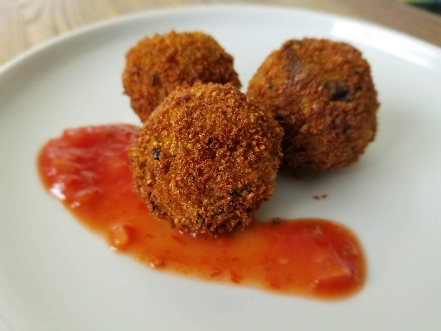 Fried balls of rice stuffed with cheese. Need we say more?
