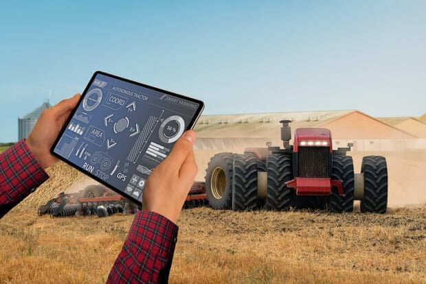 Future farming … an autonomous tractor controlled by tablet. Photograph: Scharfsinn/Alamy