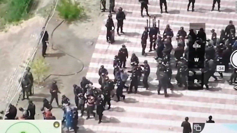 Dozens of bond and blindfolded Uyghur Muslim men being taken away by Chinese police.