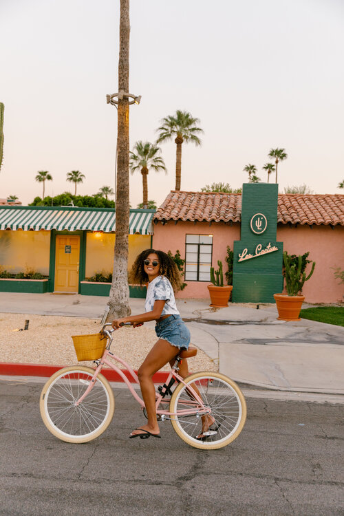 Girl on cute bicycle at Les Cactus in Palm Springs