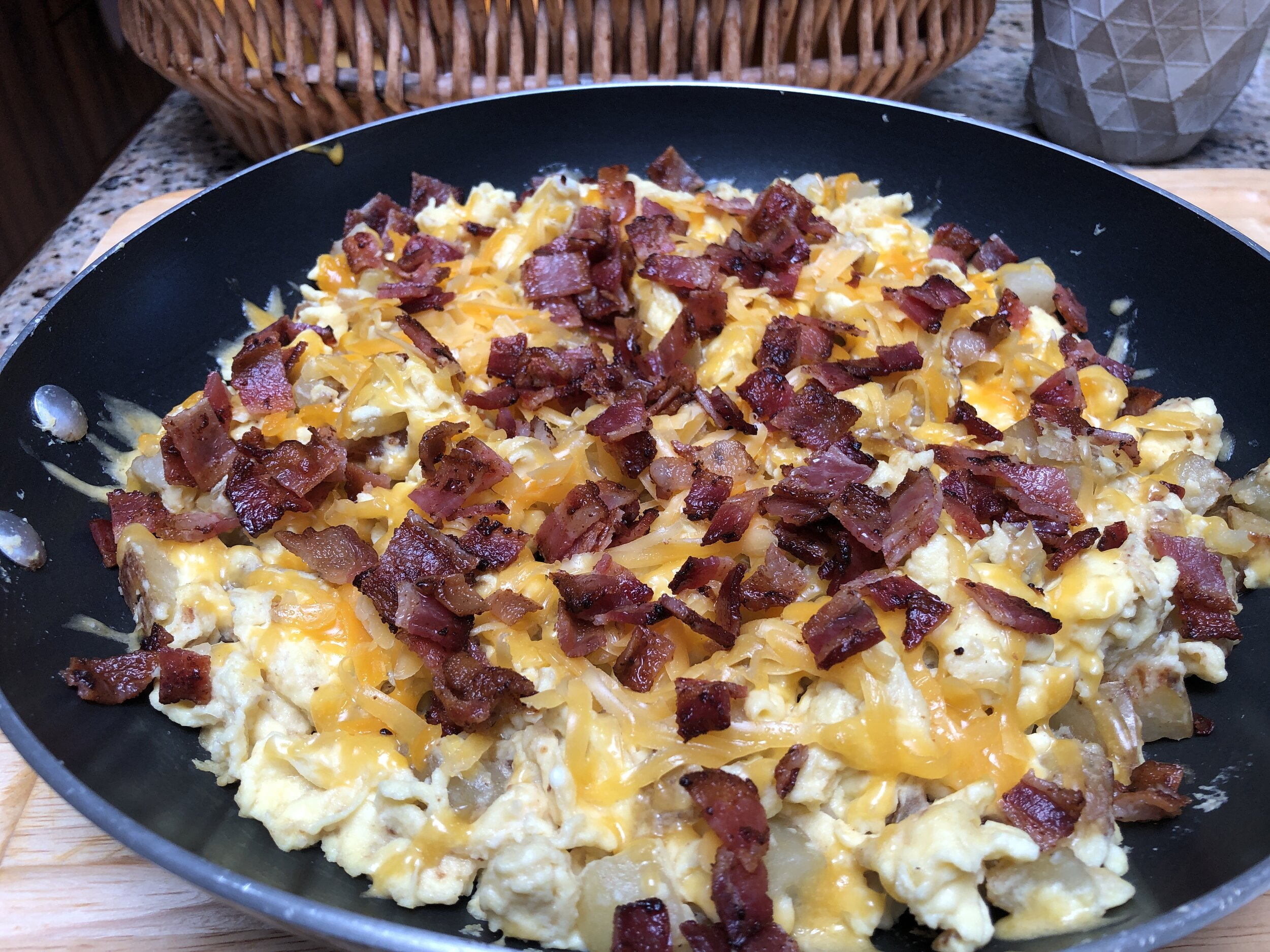 Melting the cheese of the Loaded Potato Breakfast Skillet