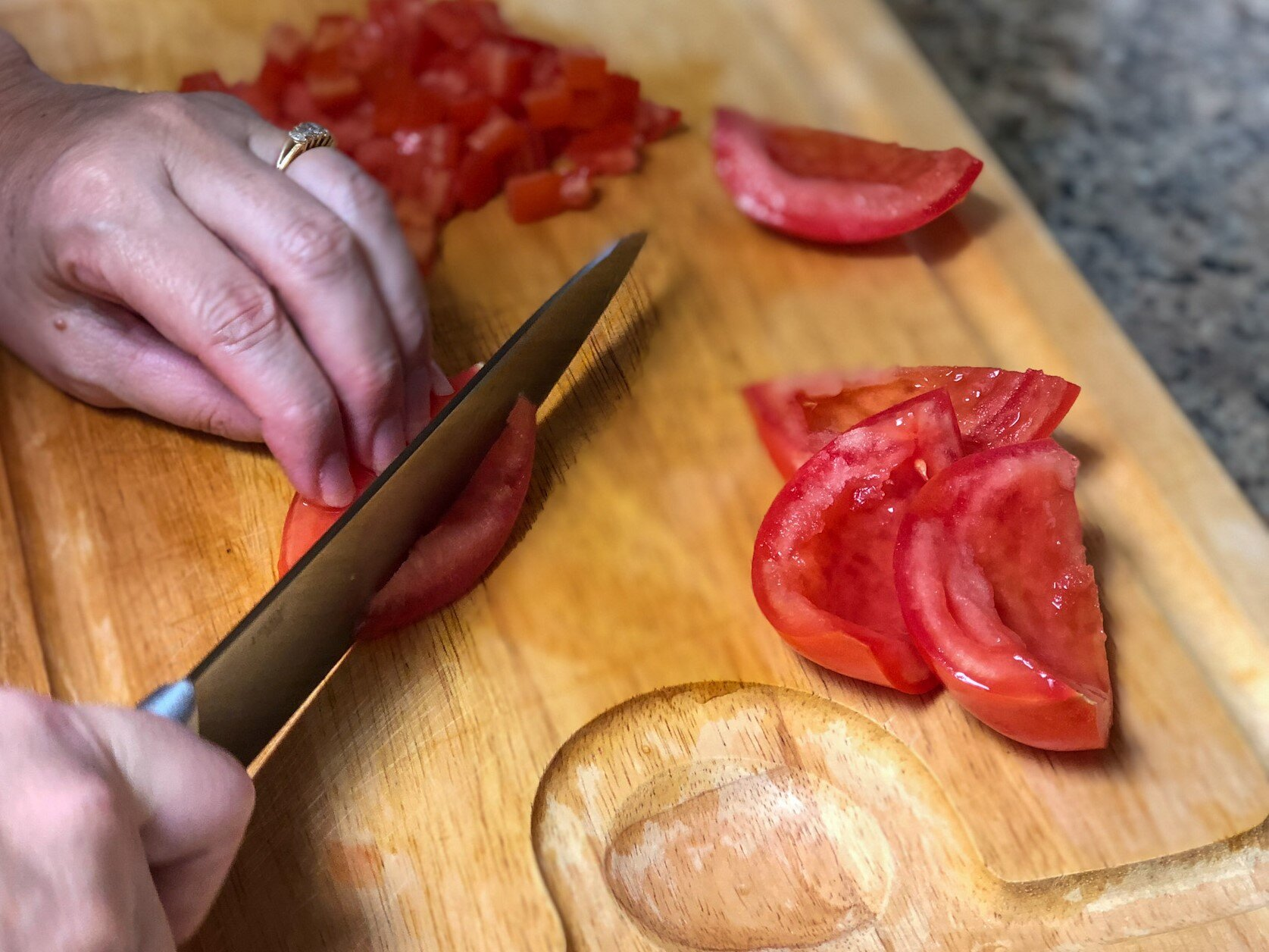 Chopping tomatoes to make Checca