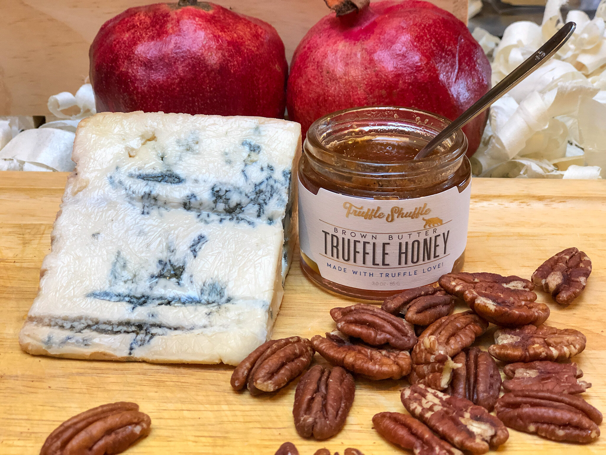 Prefect cheese board pairing: truffle honey, blue cheese, and pecans,
