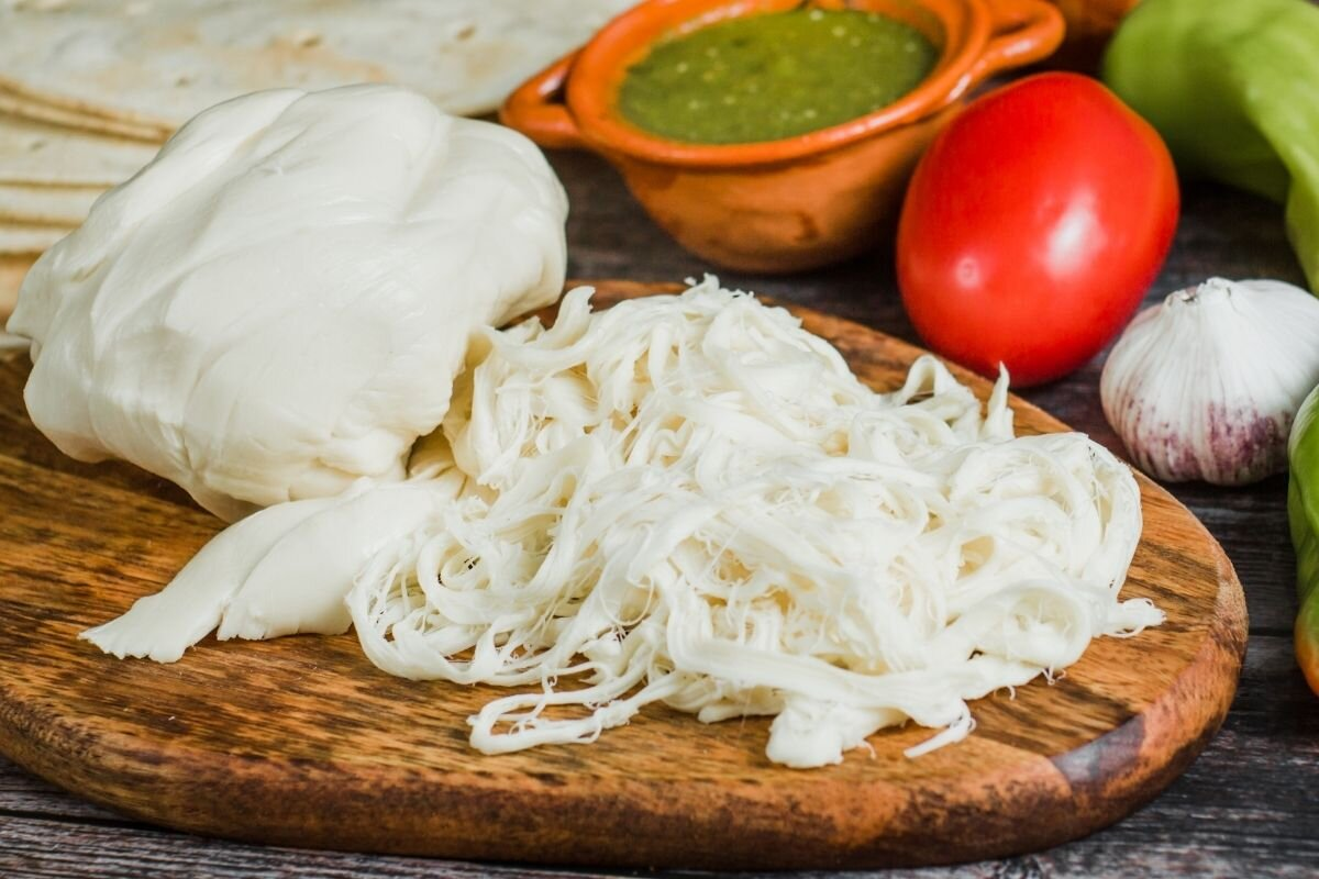 -Quesillo used to make Oaxaca's most famous street food, Tlayudas.