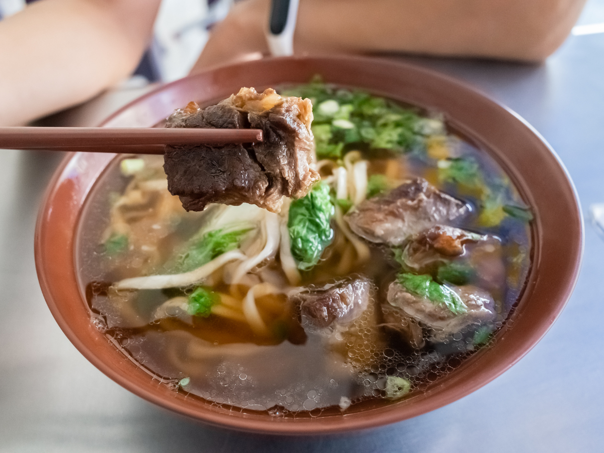 A bowl of Beef noodle soup, a Taiwan street snack.