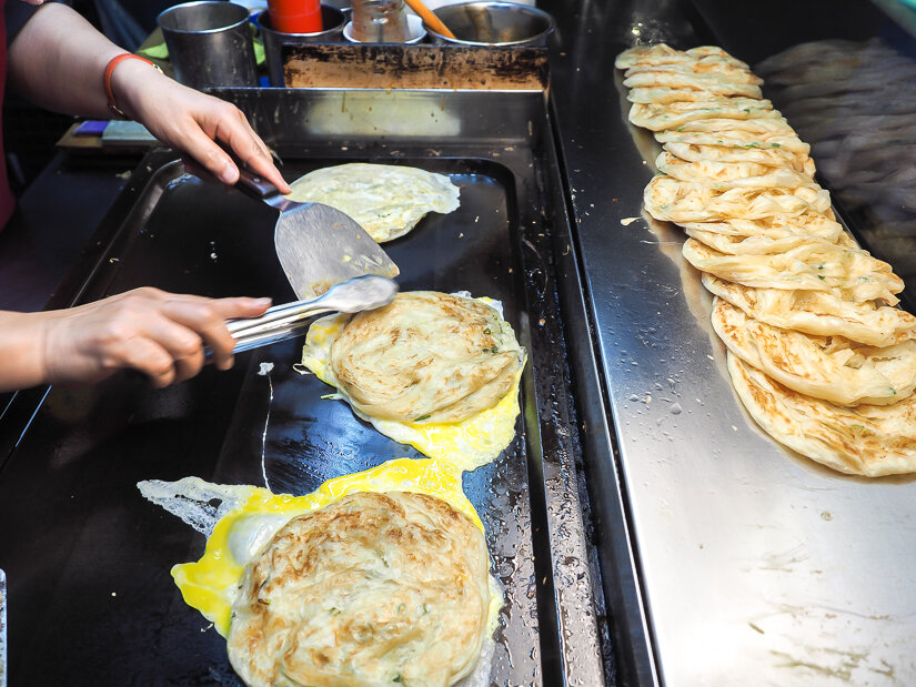 A griddle filled with the Taiwanese snack, Green Onion Cakes.