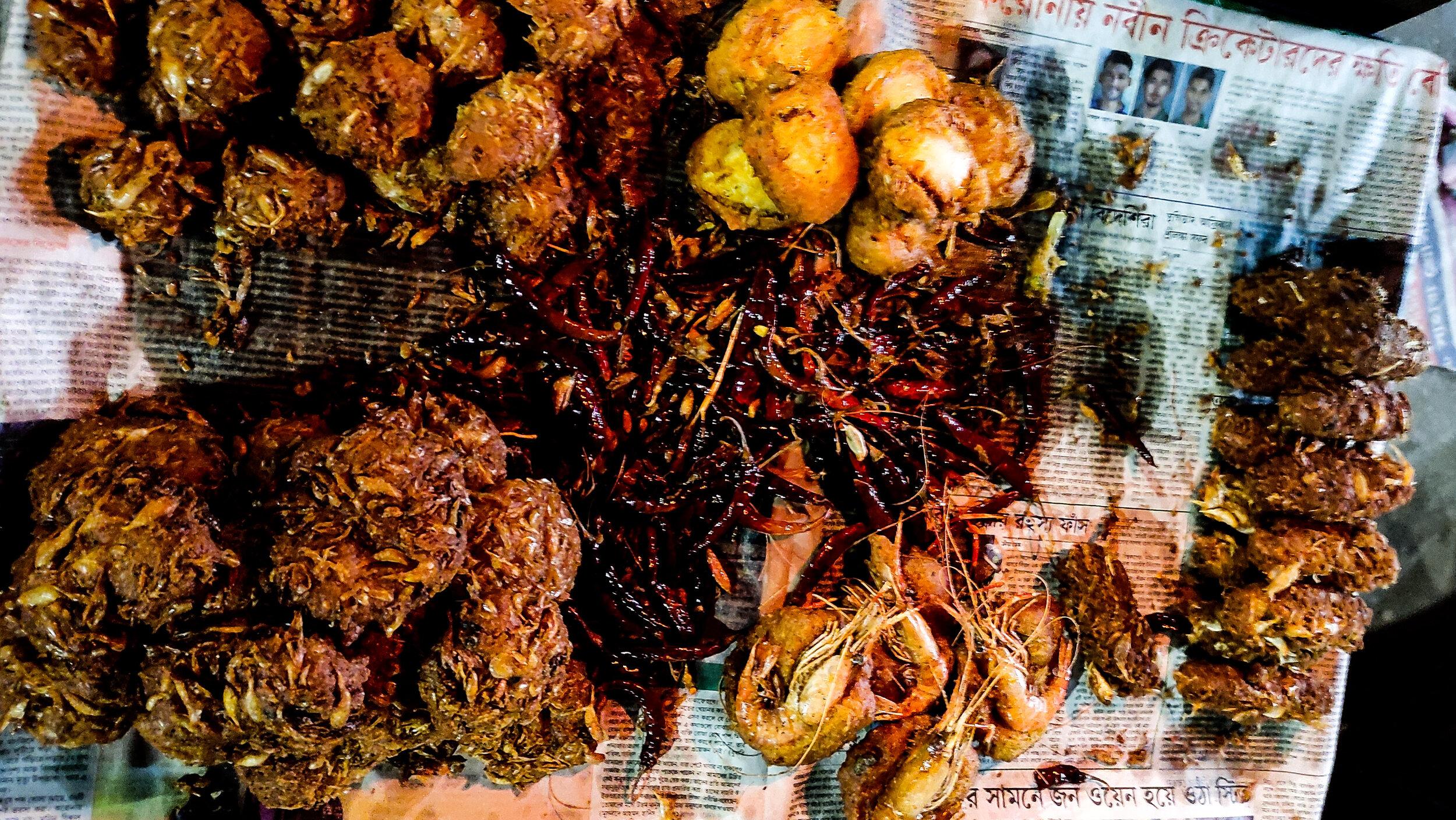 The traditional Bangladeshi foods Peyaju, Beguni, and Chop.