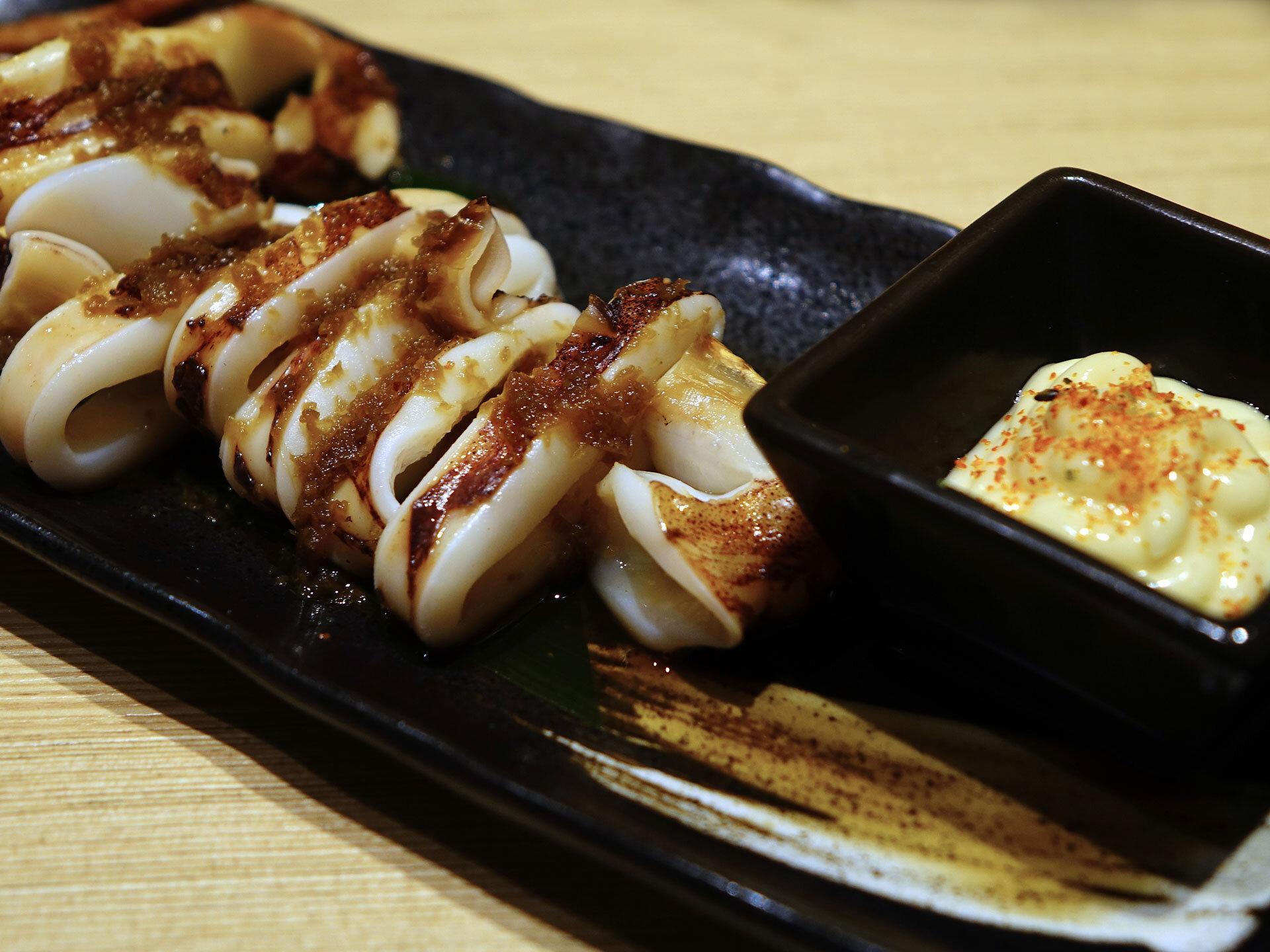 Japanese street food Ikayaki, grilled squid.