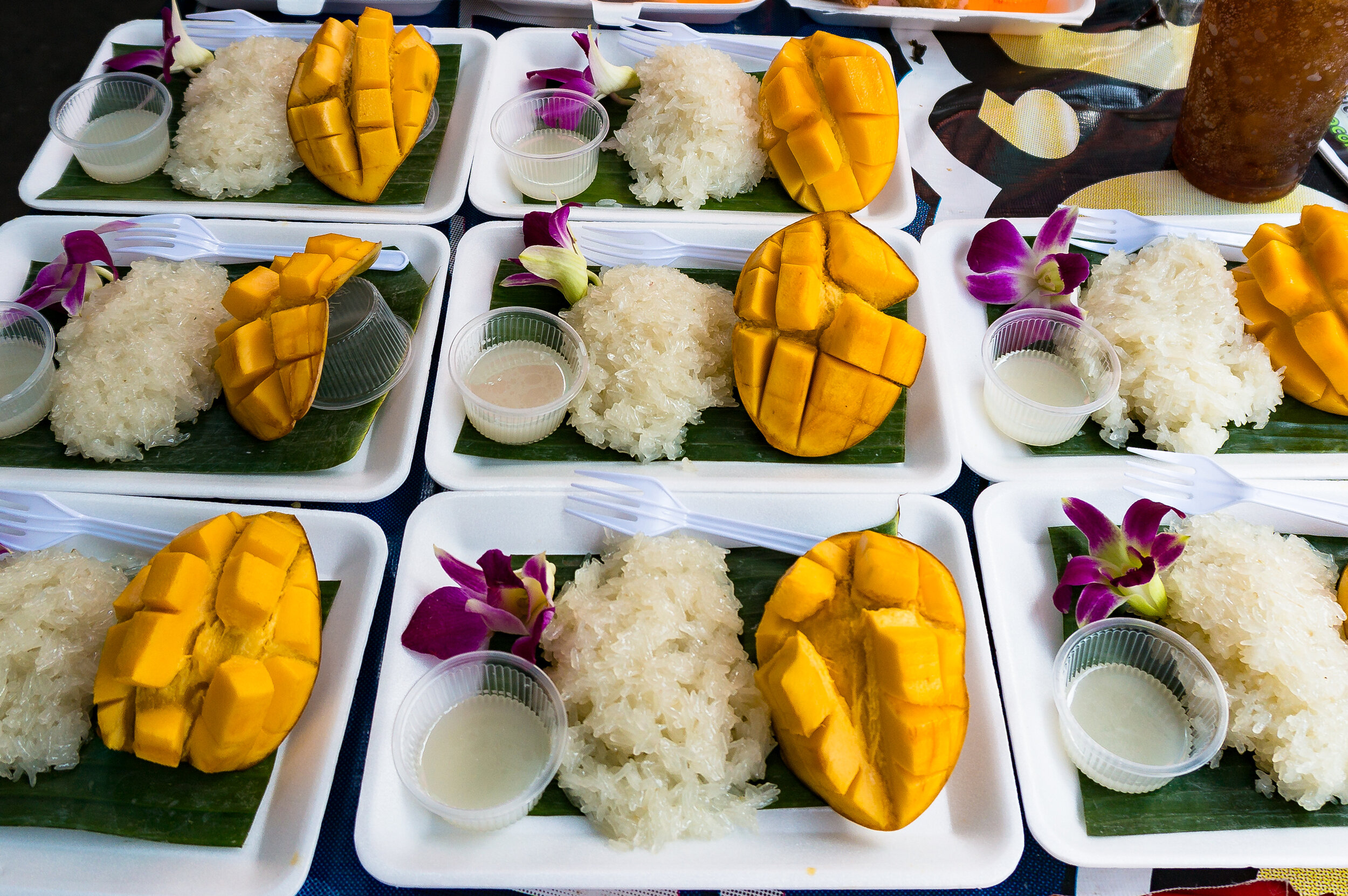 Dessert Thai street food, mango sticky rice in Bangkok.