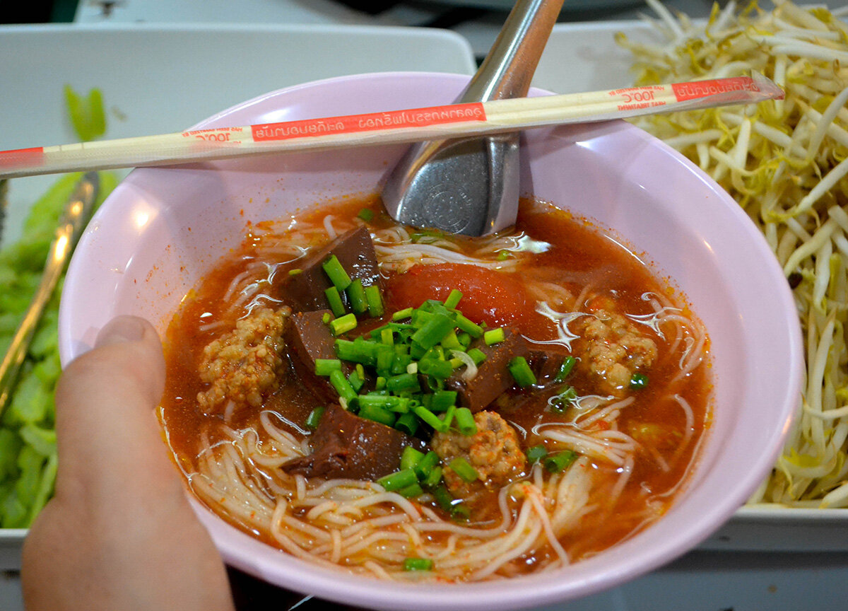 Khanom Jeen Nam Ngiao, a popular street food in Chiang Mai.