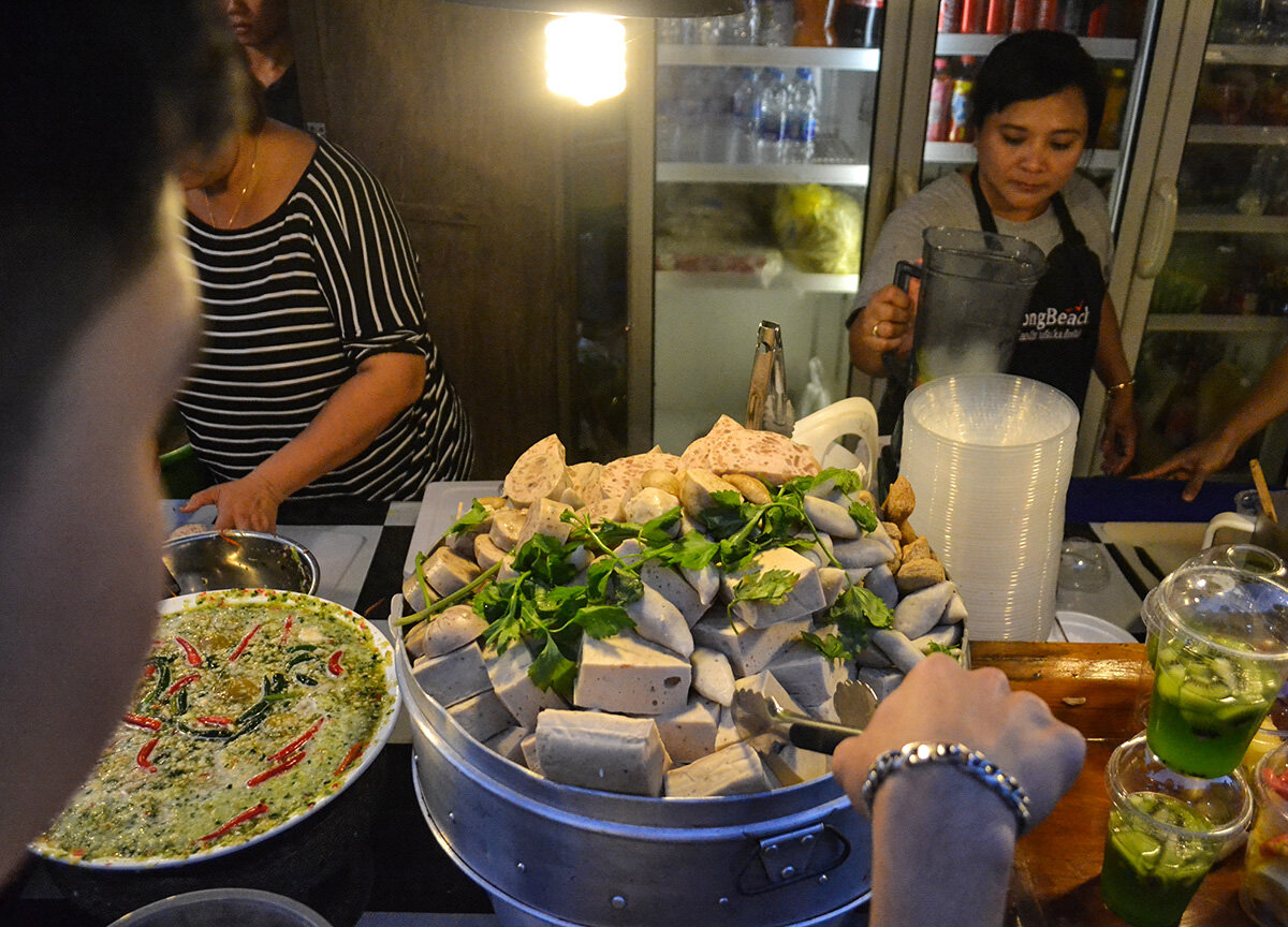 Sausages are common street foods in Chiang Mai.