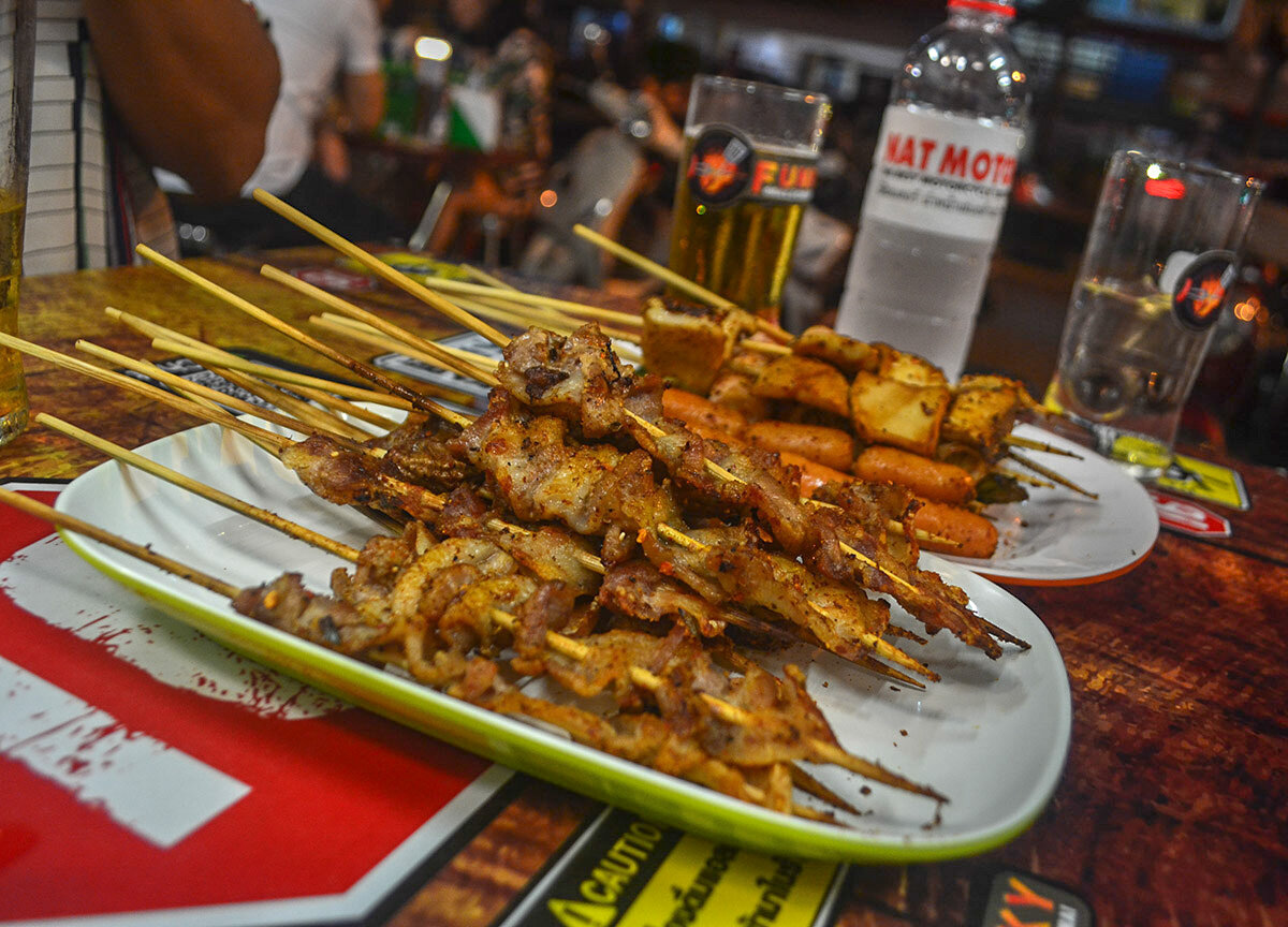 Street food in Chiang Mai includes kebabs.