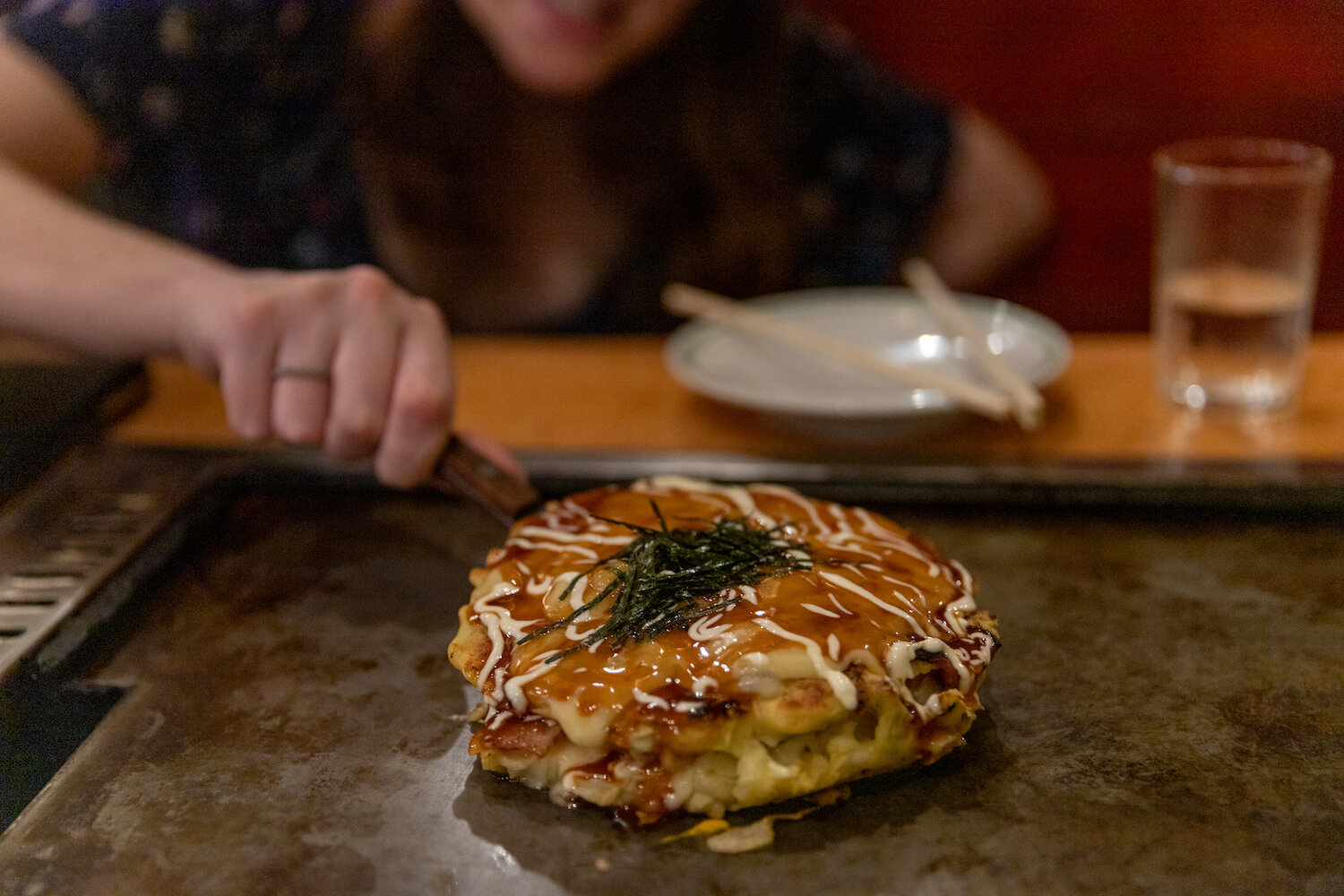 The Japanese pancake, Okonomiyaki is a specialty food in Osaka and the making of it can be an Osaka restaurant show.