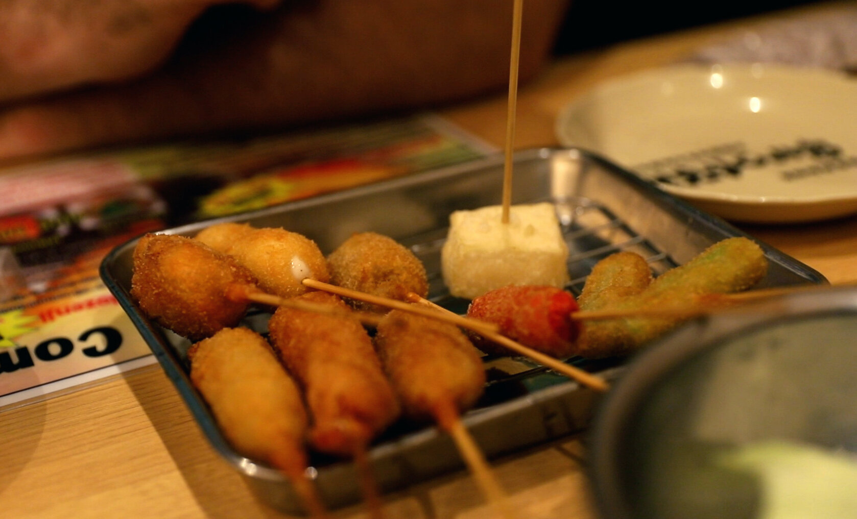A popular Japanese food in Osaka, Kushikatsu, is a combination of fried meats and vegetables.