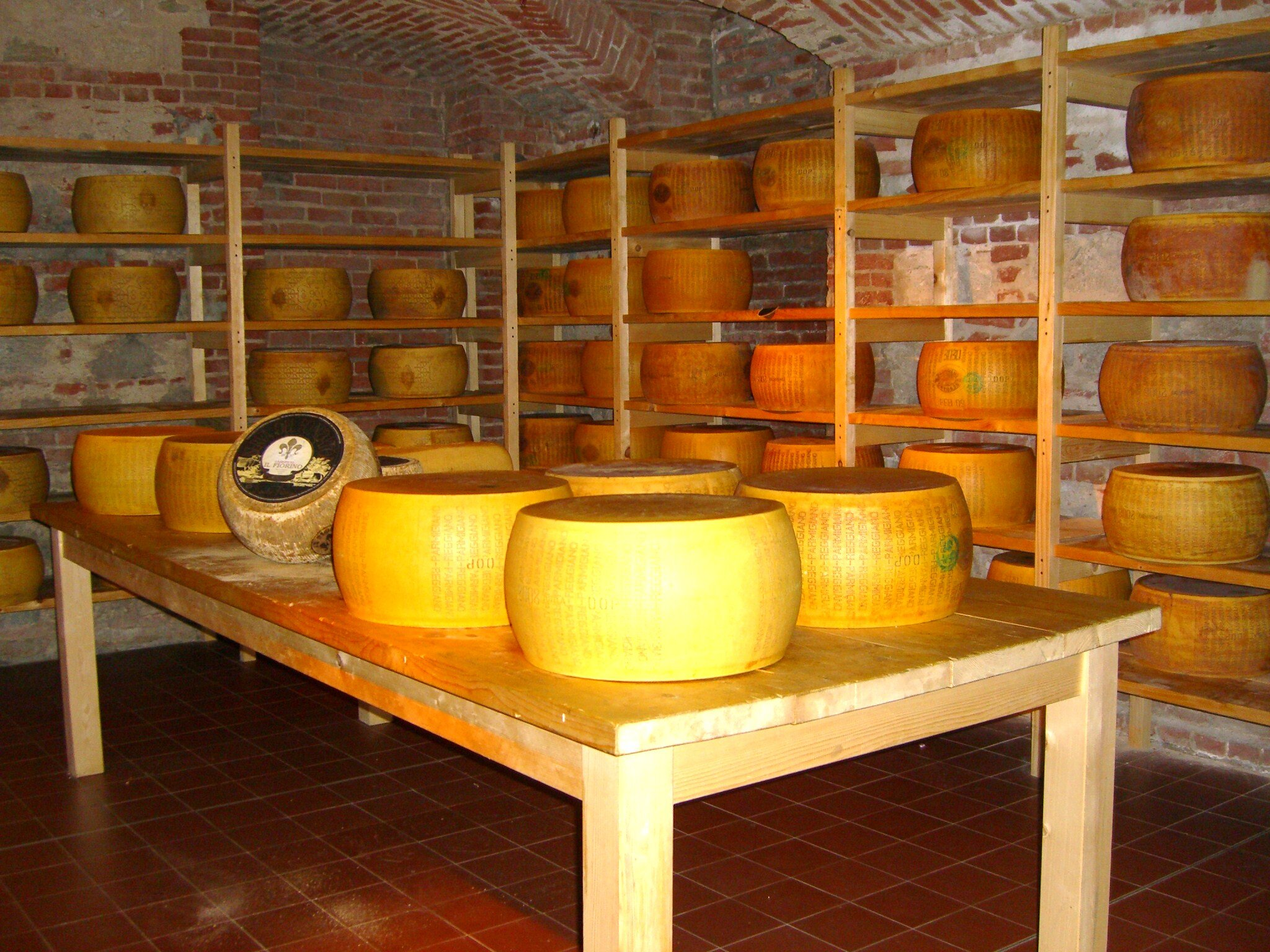 Wheels of Parmigiano Reggiano, one of the most famous food products from Italy.