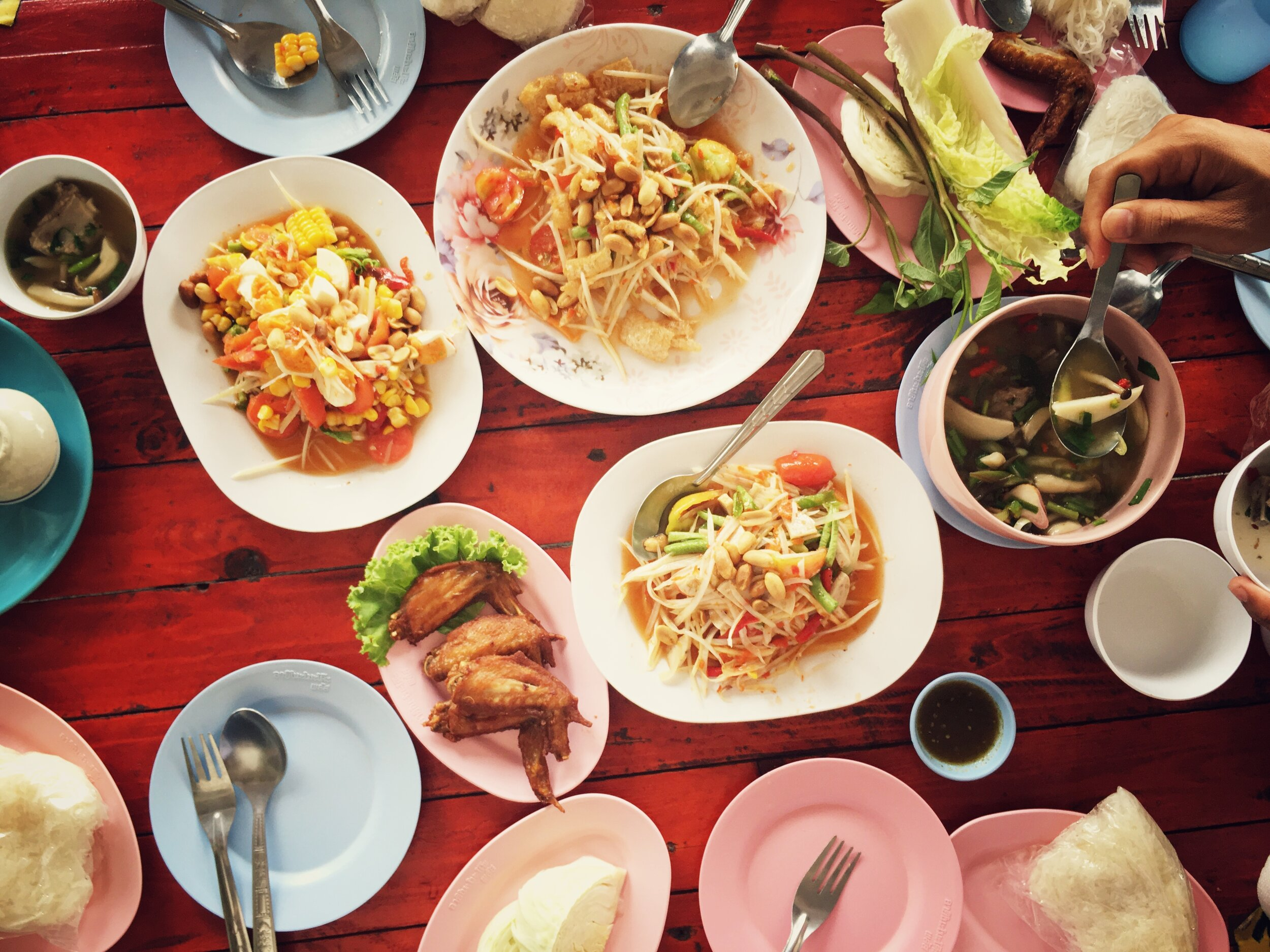 Authentic Bangkok foods being shared as is the tradition in Bangkok cuisine