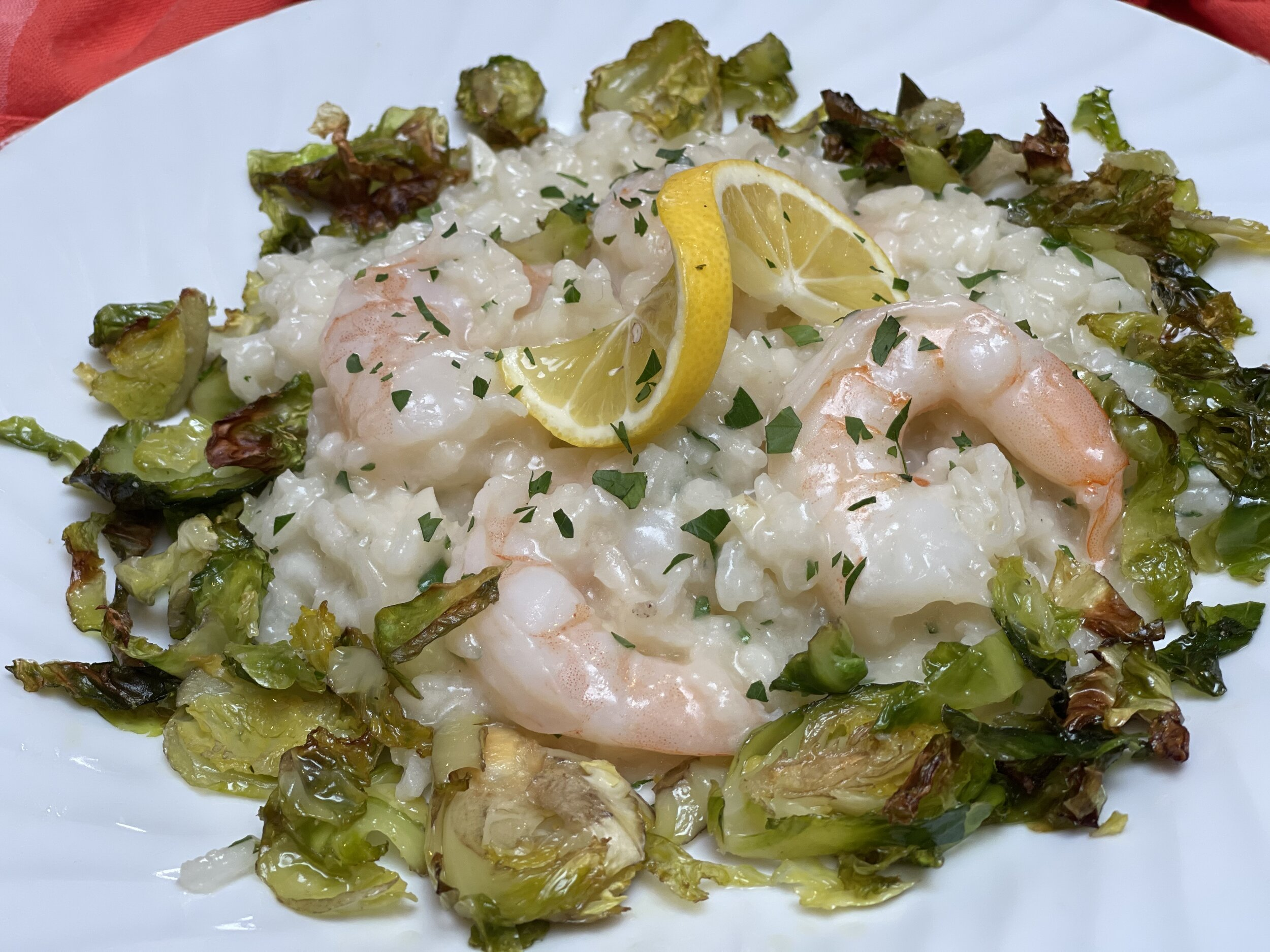 Serving Prawn Risotto with a side of roasted Brussels sprouts.