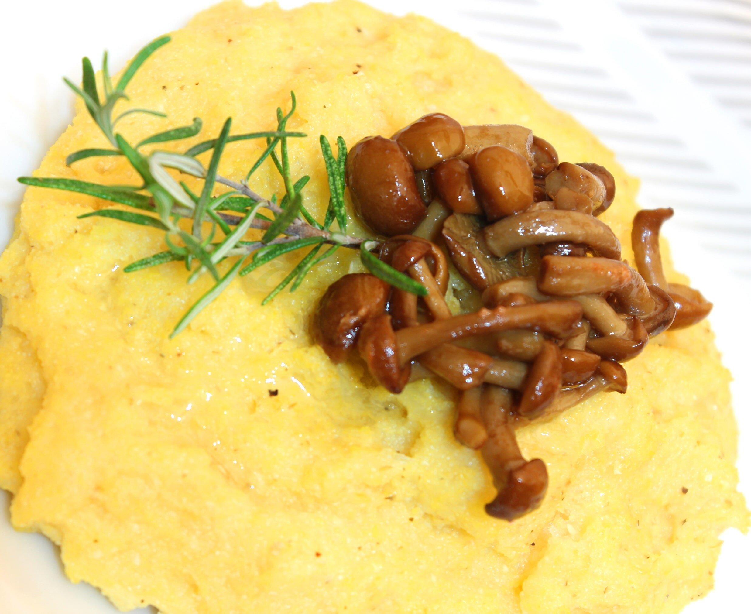 Italian vegan polenta topped with mushrooms.