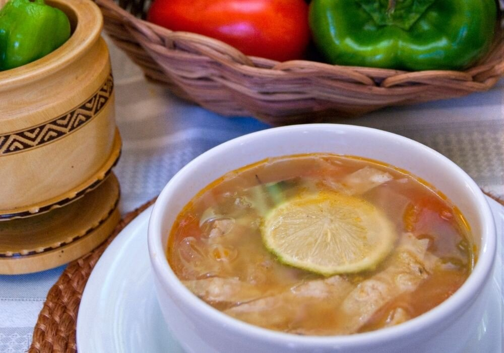 The traditional Yucatan dish, Sopa de Lima is a delicious chicken and vegetable soup.