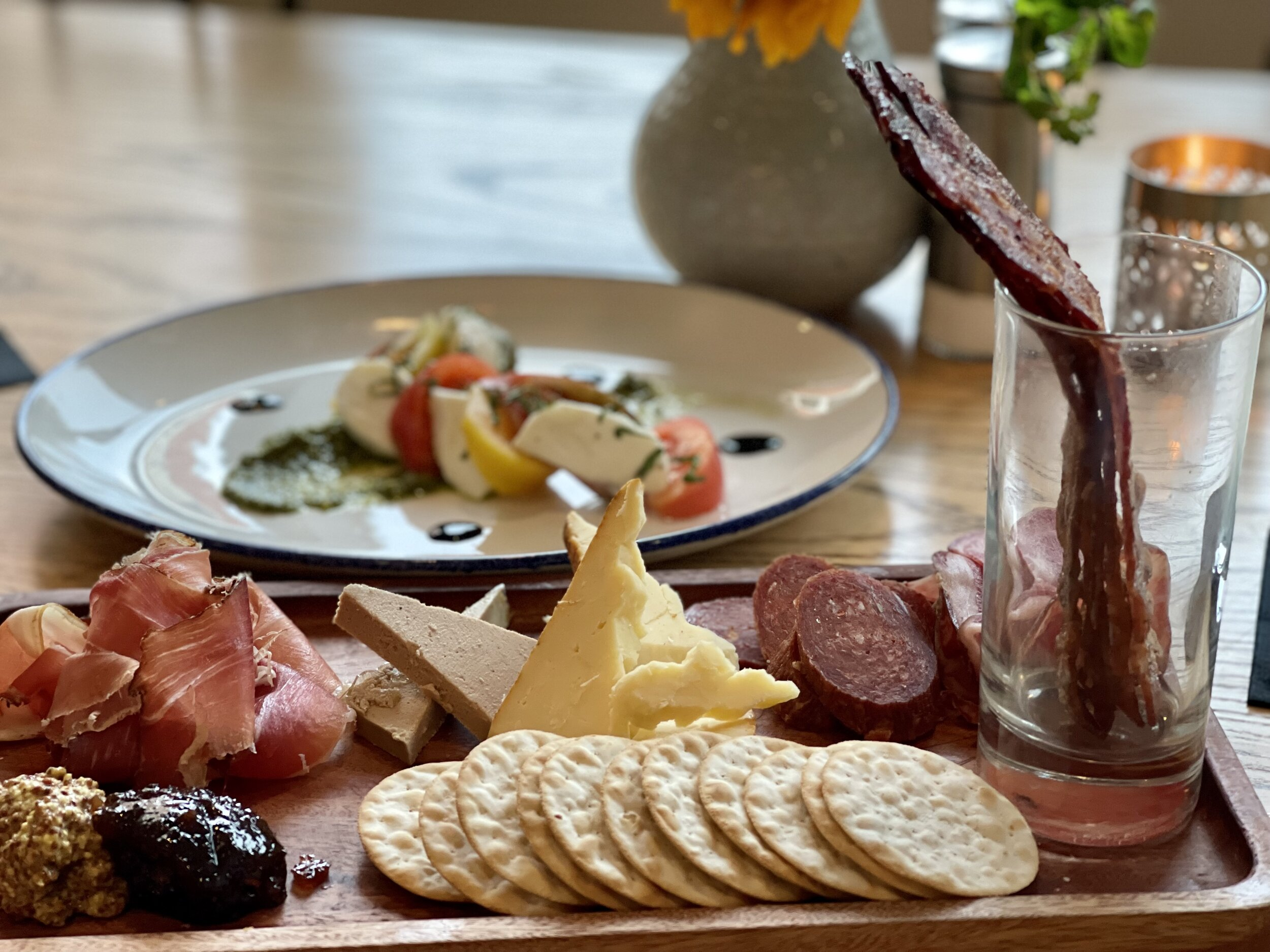 Caprese Salad and Charcuterie Board at 22 Square in the Adaz Savannah boutique hotel
