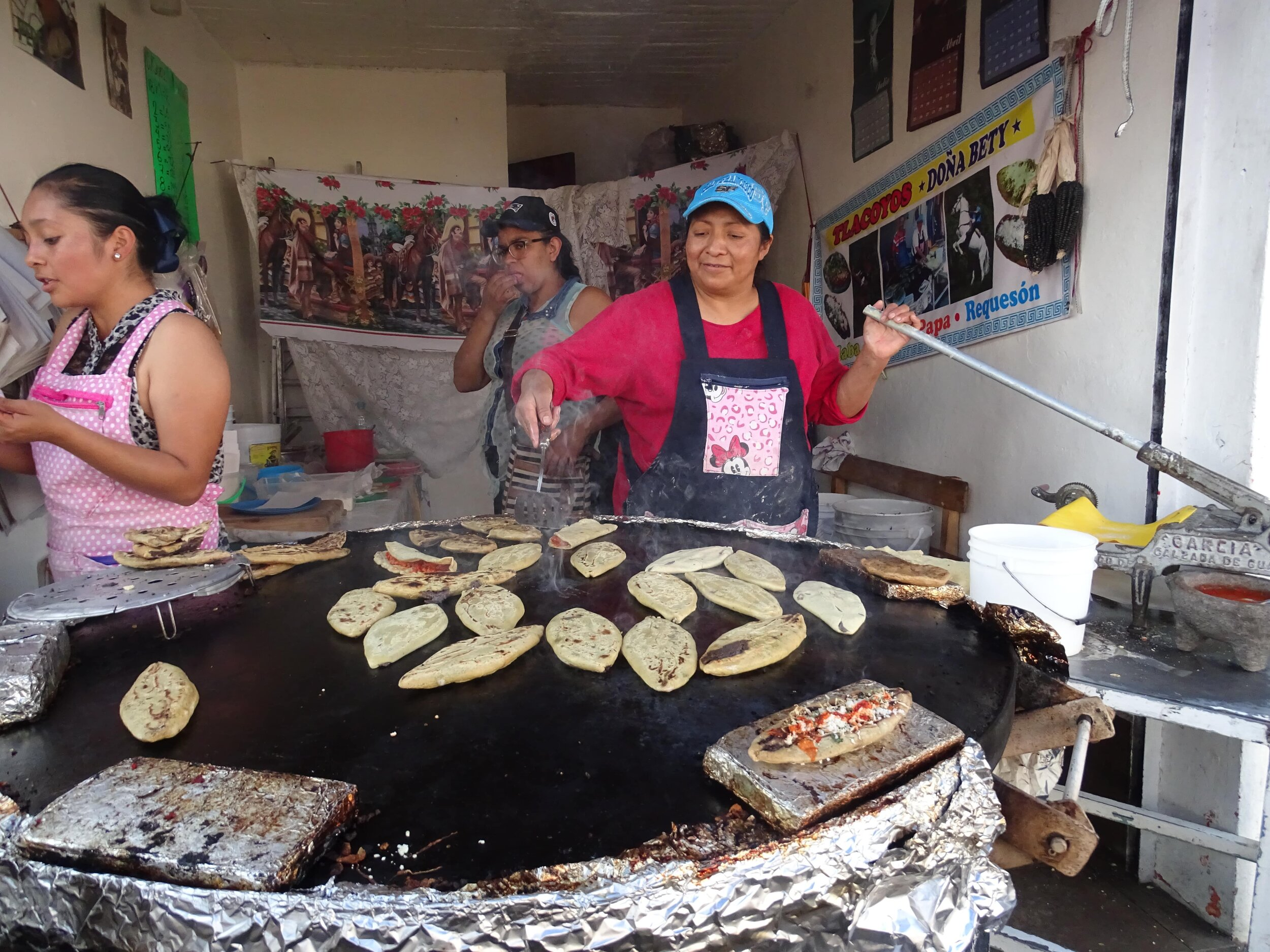 Making the Mexico City street food tlacoyo.