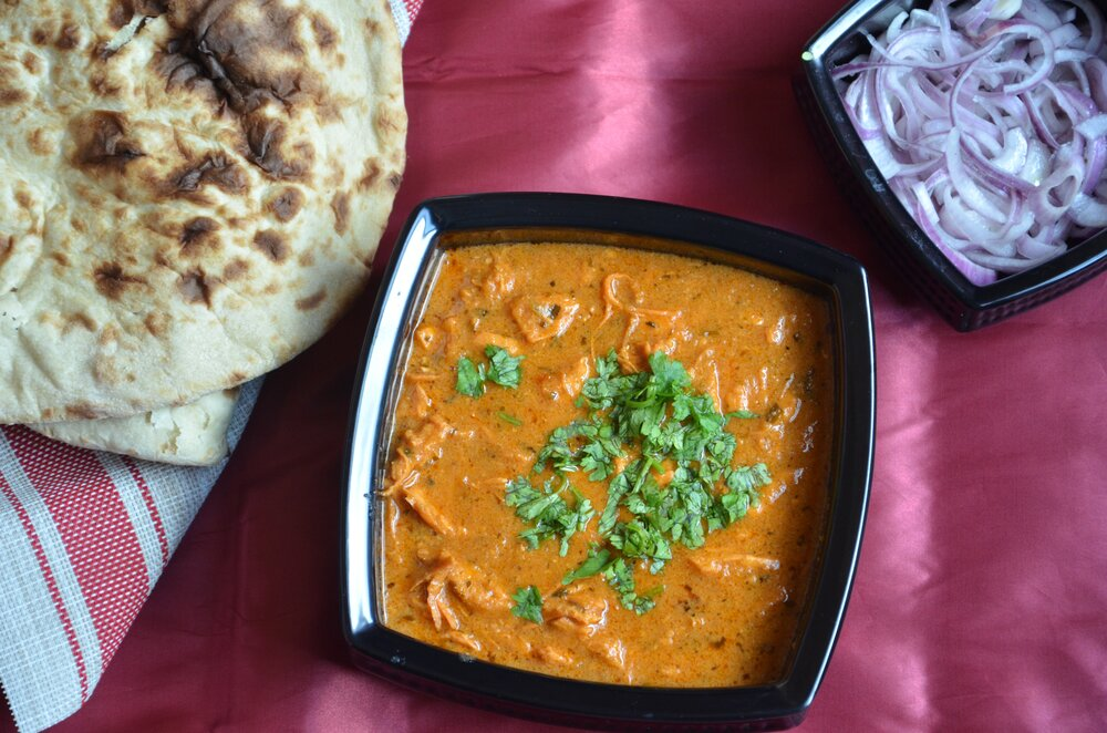 Generously laden with butter and cream, butter chicken is not surprisingly a beloved comfort food. Photo by Saher Suthriwala / Pixels