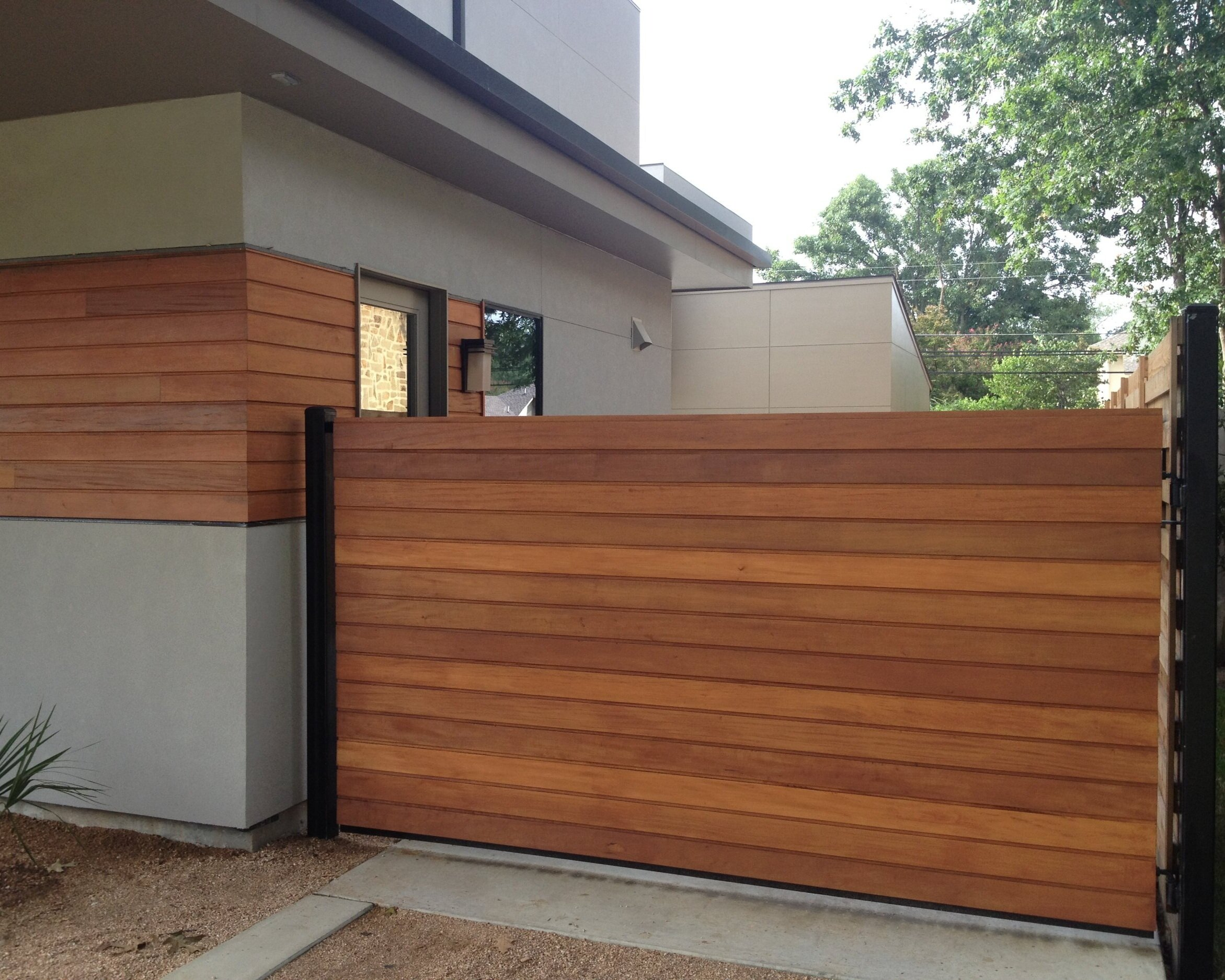 "Wood & Iron Gates - Drive gates provide a higher level of safety and security. Gain additional ""safe area"" for play, while enhancing the beauty and privacy of your home. Let us build you a custom gate your neighbors will […]"