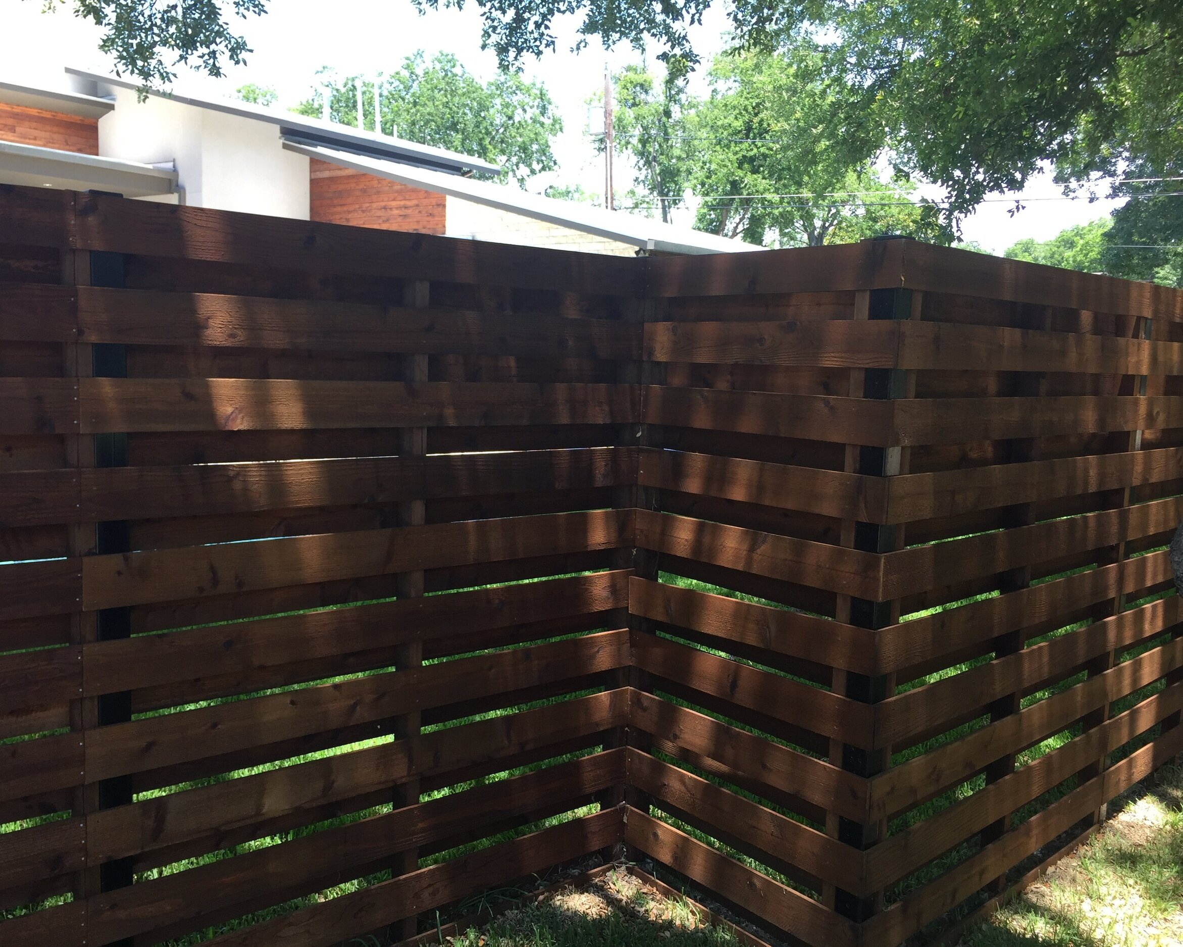 Wood Fence  - The natural beauty of wood done right cannot be rivaled. Global Fence uses only top grade cedar and we hand dip stain our wood to offer beauty and durability that will last for many years