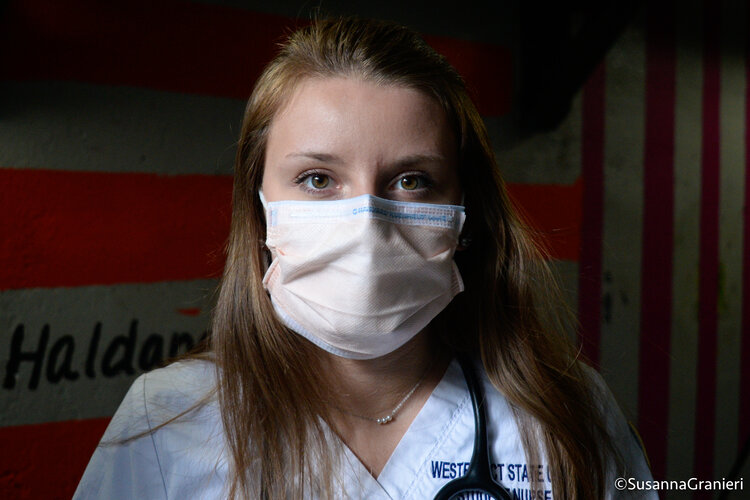 Ashley Valentino wears her surgical mask along with her Western Connecticut State University scrubs, which she would be wearing for her hospital rotations prior to COVID-19.