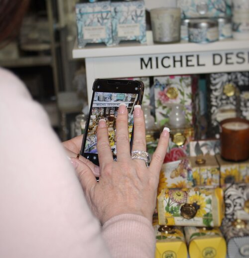 Pepe takes photos of new products in the store to post to their social media accounts. Photo by Kerri Kolensky.