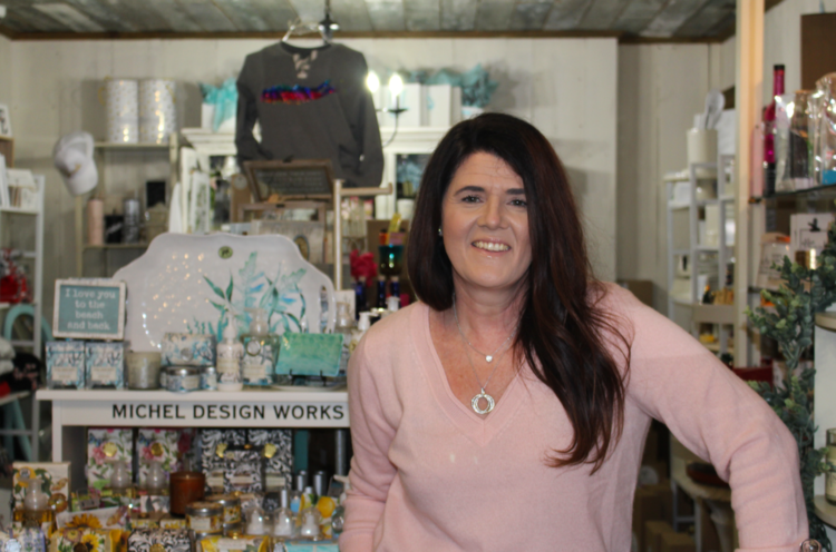 Cheryl Pepe stands where people in the community can find her two days a week: on the floor of On a Whim Gift Boutique, the shop she opened in 2012. Photo by Kerri Kolensky.