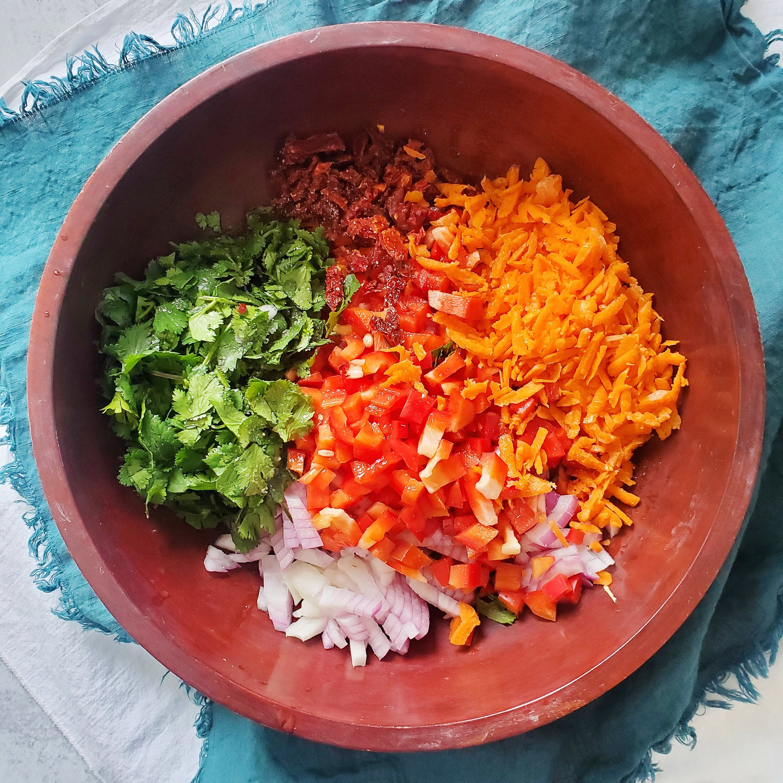 Chop all the veggies and add to a large bowl. Add the oil, lemon juice, and salt & pepper -