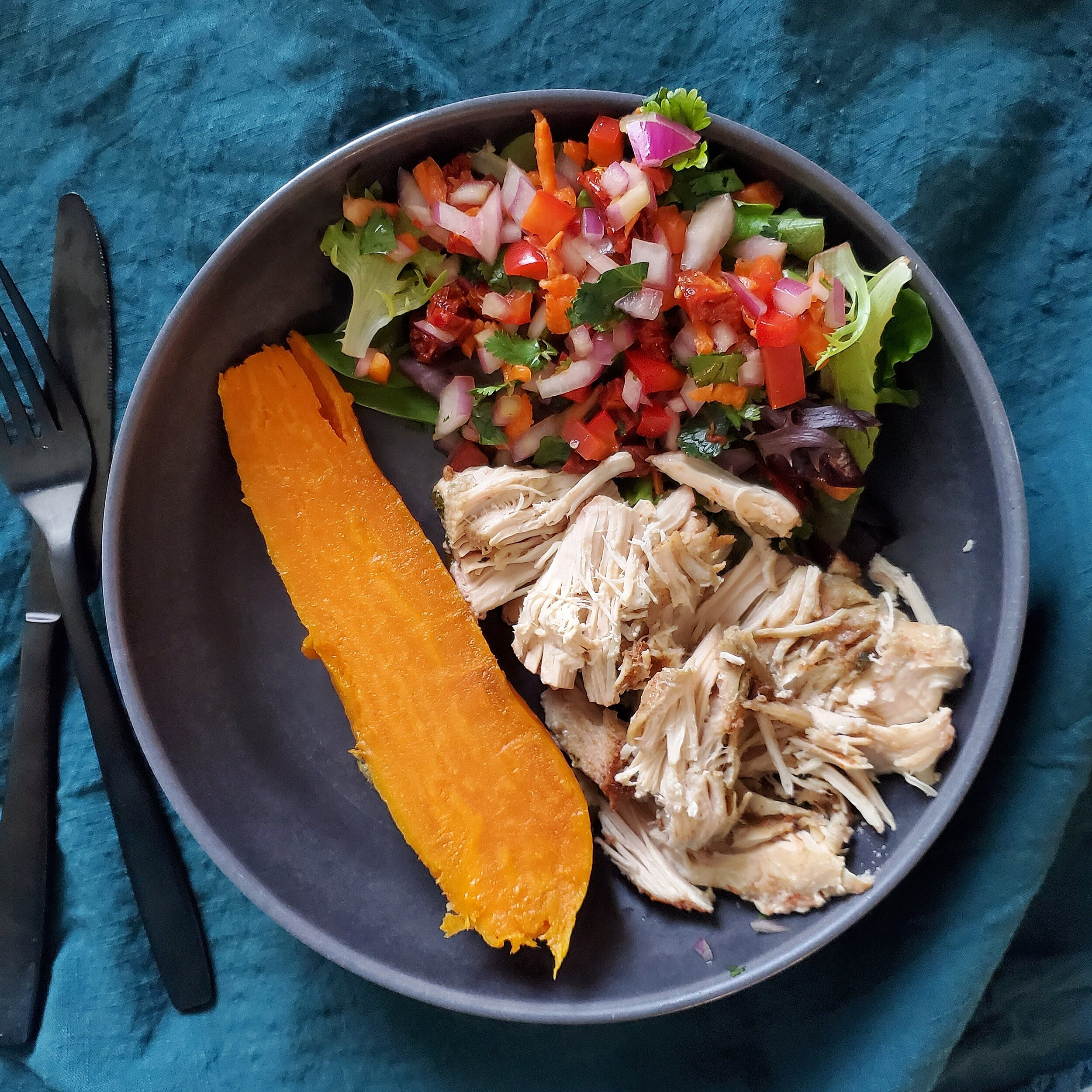 Add 5 oz of shredded chicken, 1/2 sweet potato, 1/2 cup spring mix salad, and 1/2 cup of veggie salad/vinaigrette.  Add a little BBQ sauce, mix up and enjoy! -
