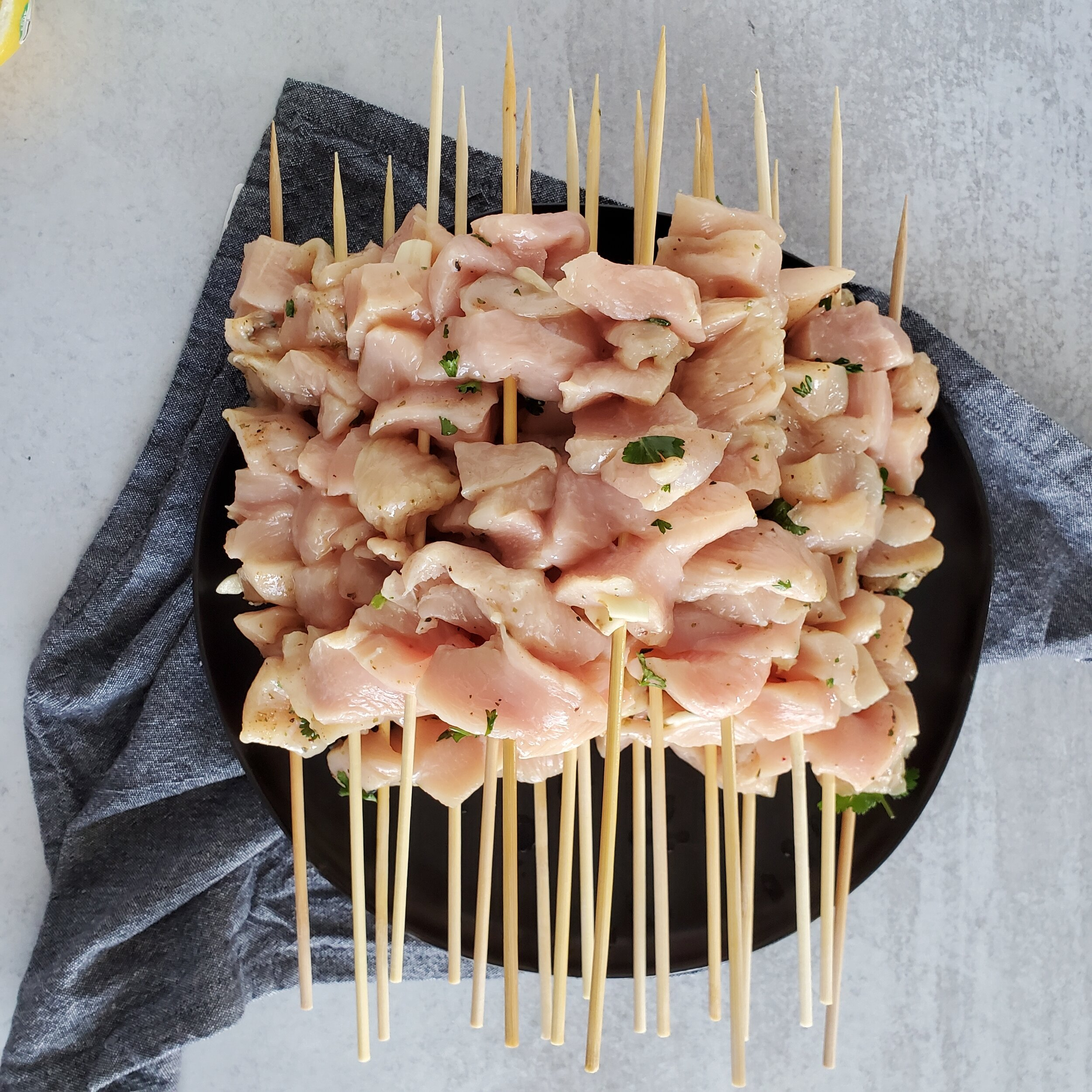 Add 8 chunks of chicken to each skewer. Don't overcrowd each piece of chicken, let there be a little space so the chicken can cook evenly. -