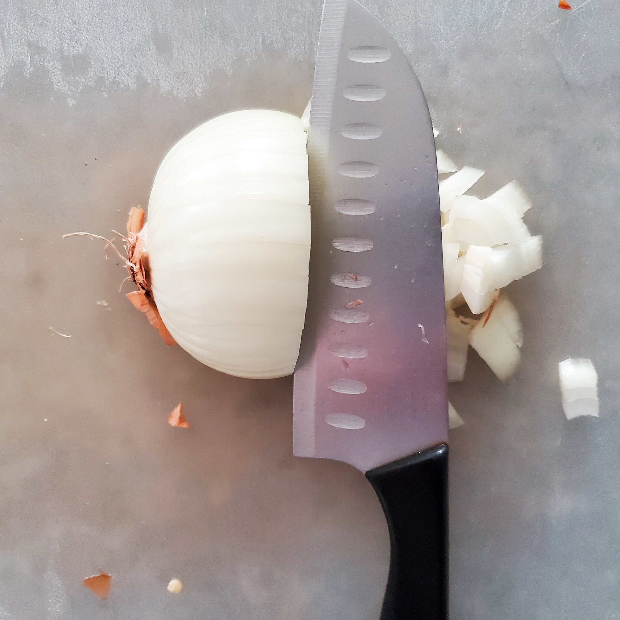 Next turn the onion so the root is to the side. Now make vertical cuts, until you reach the root. Now you have perfectly chopped onion. -