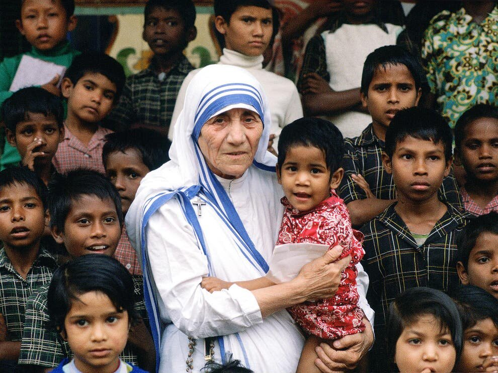 Image credit:   Mother Teresa with a group of children who she looked after in December 1980 (bbc.co.uk/newsround/50075153)