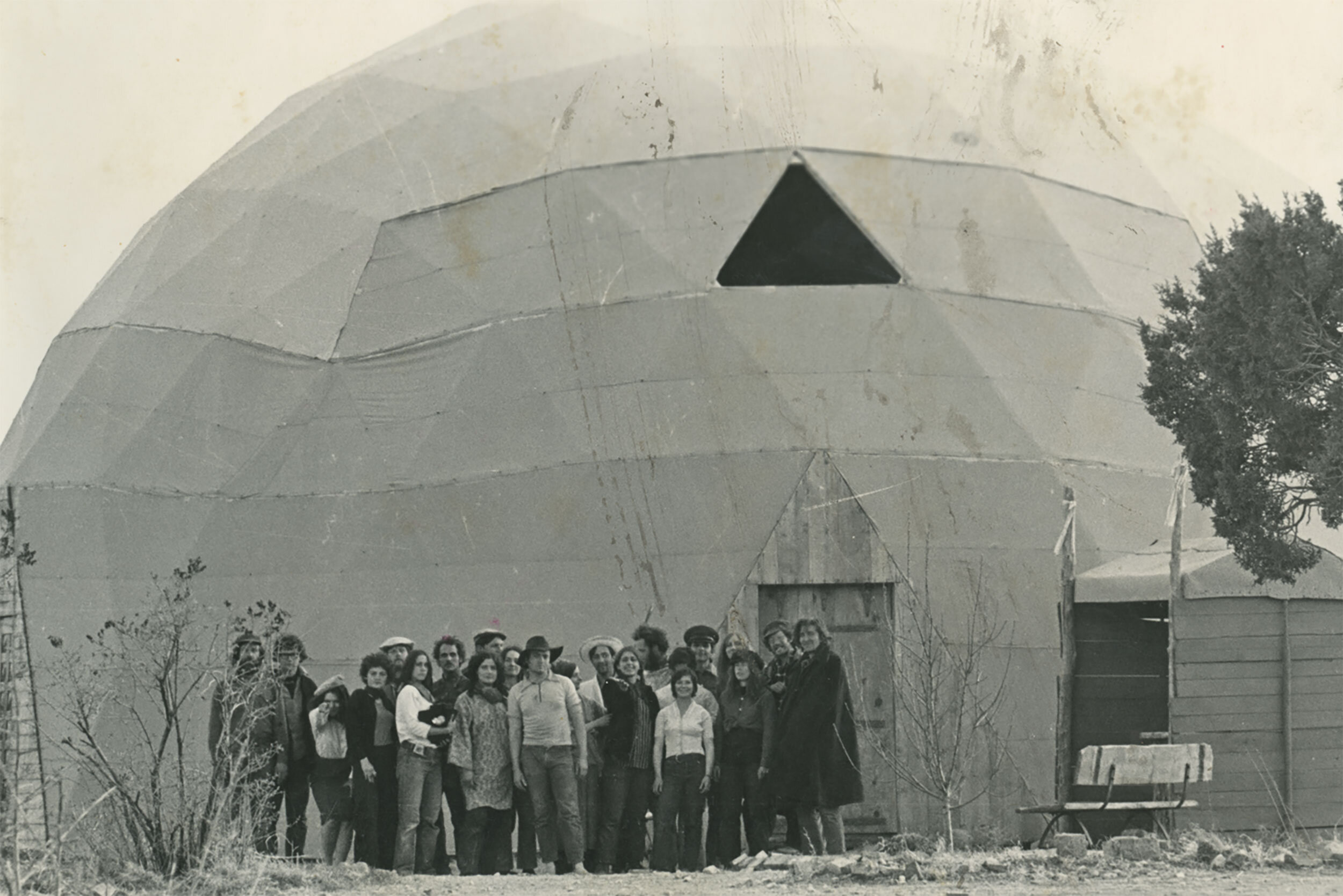 Synergists standing in front of geodesic dome at Synergia Ranch