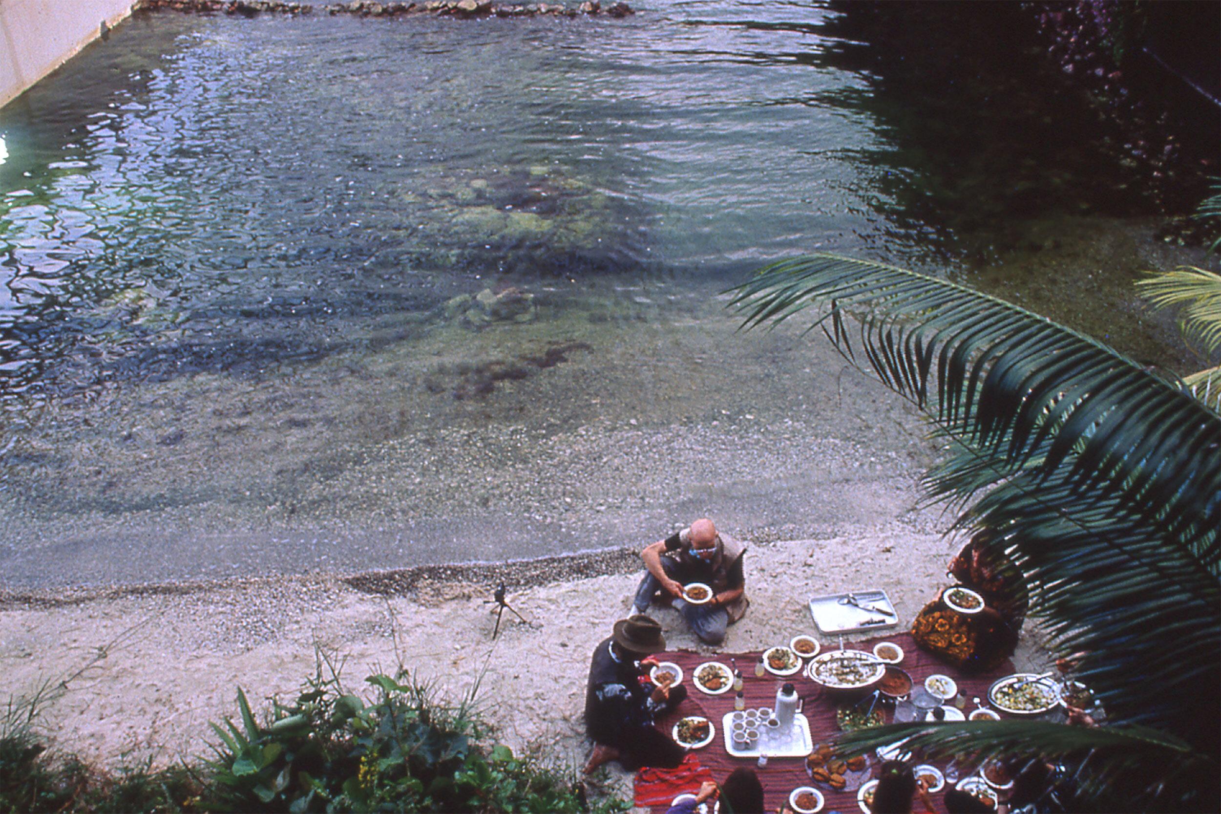 Biospherians enjoying a meal by the ocean biome