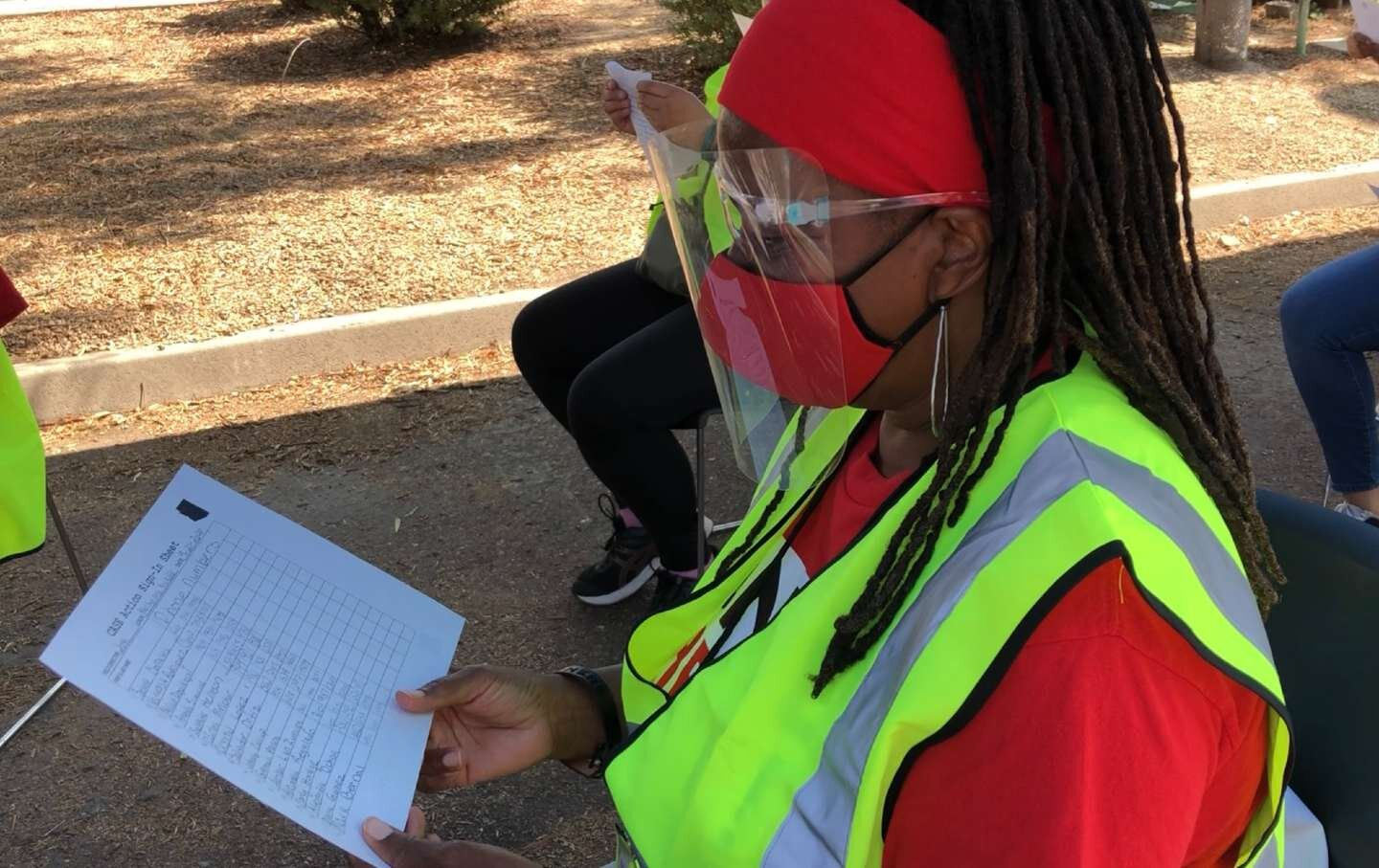 A UNITE HERE union member reviews a block walking list in Arizona.