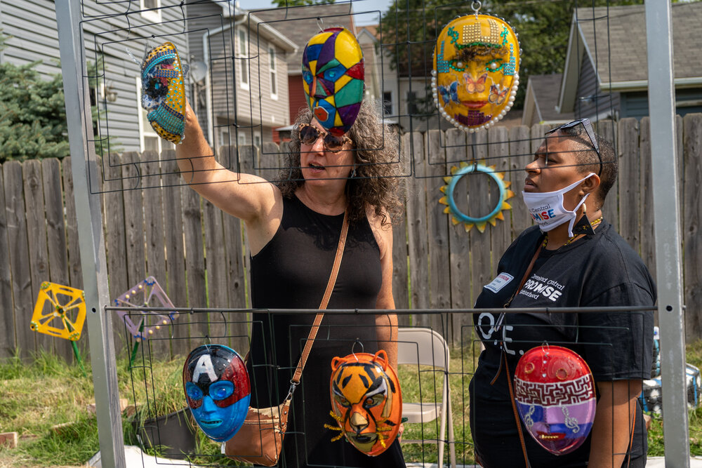 Visitors admire handmade masks. Contributed photo from C.O.P.E