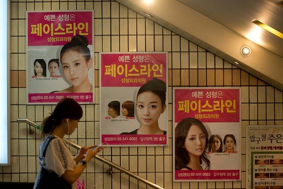 Ads for plastic surgery in Seoul, Korea.   Photo Credit: wsj.com; Agence France-Presse/Getty Images