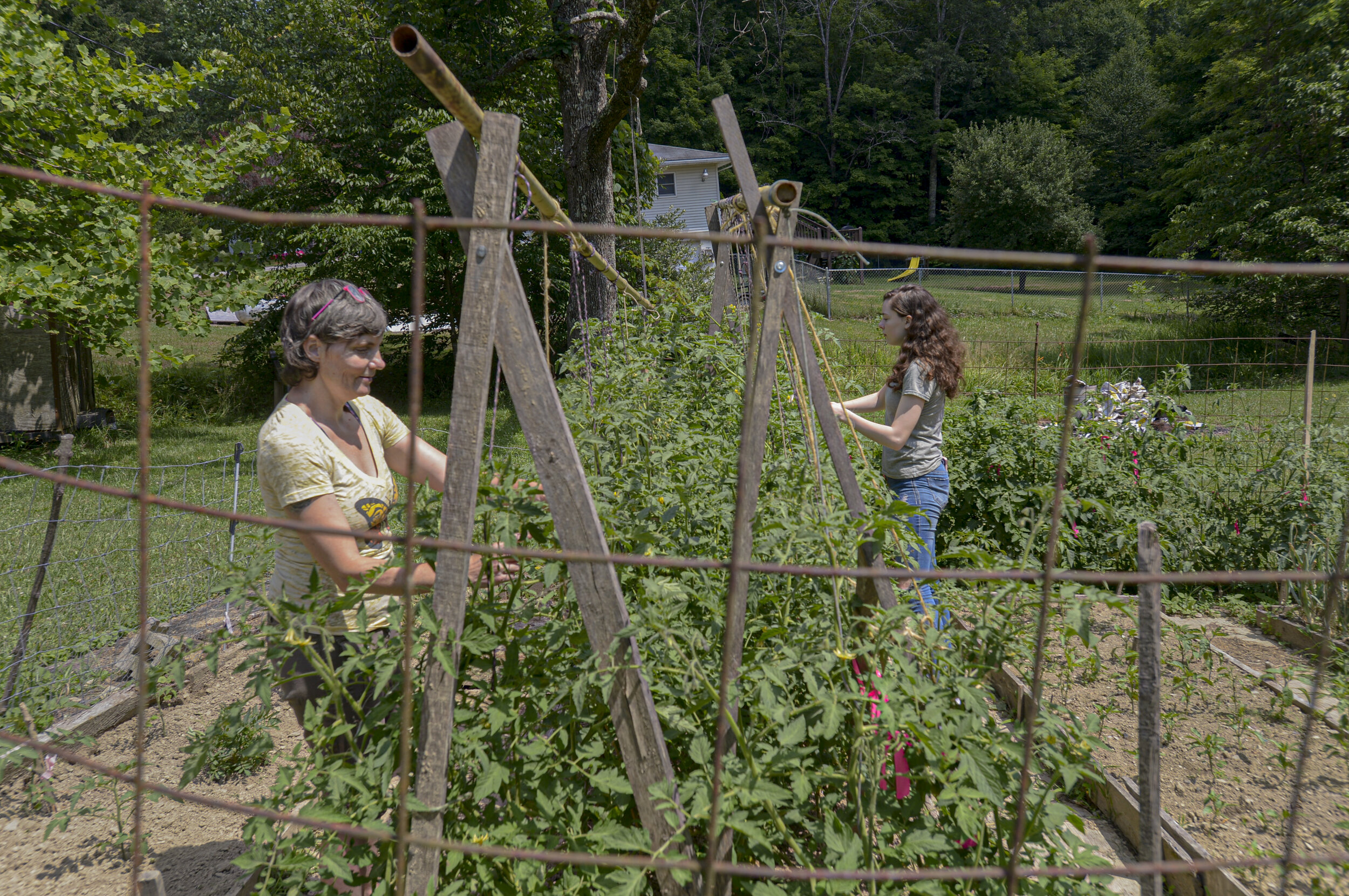 Jennifer Boyle-Hempel and her daughter, Laura Hempel, 17, tend to their family garden on July 13, 2020, in Randolph County. The farm is about 30 minutes away from the nearest school summer feeding site. Photo by F. Brian Ferguson