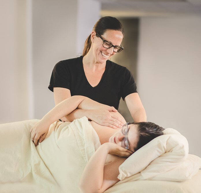 One of Red Moon's expert LMTs, Kari, giving a prenatal massage.