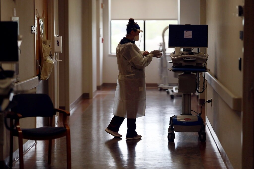 A dialysis specialist donned personal protective equipment before treating a patient with coronavirus in a Maryland hospital. Kidney function is one of several factors doctors evaluate differently according to race.Credit...Win Mcnamee/Getty Images