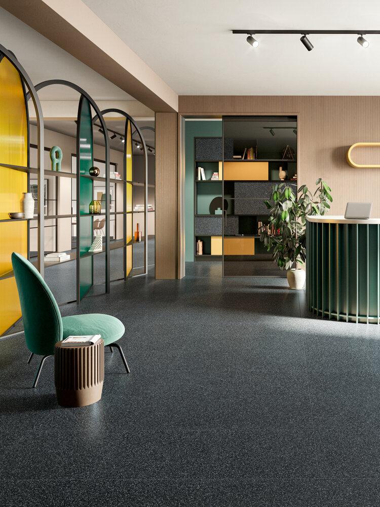 Fioccio Black small chip in a room setting. designer tile found in ajami surfaces in miami for flooring, and granite