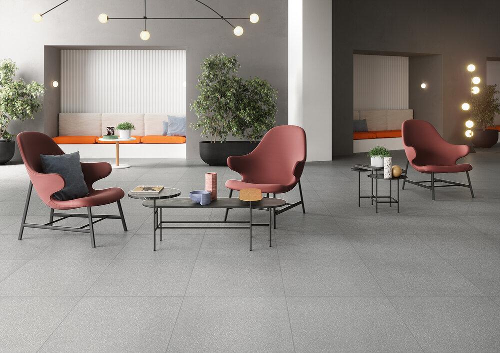 Fioccio dark grey small chip in a room setting. designer tile found in ajami surfaces in miami for flooring, and granite
